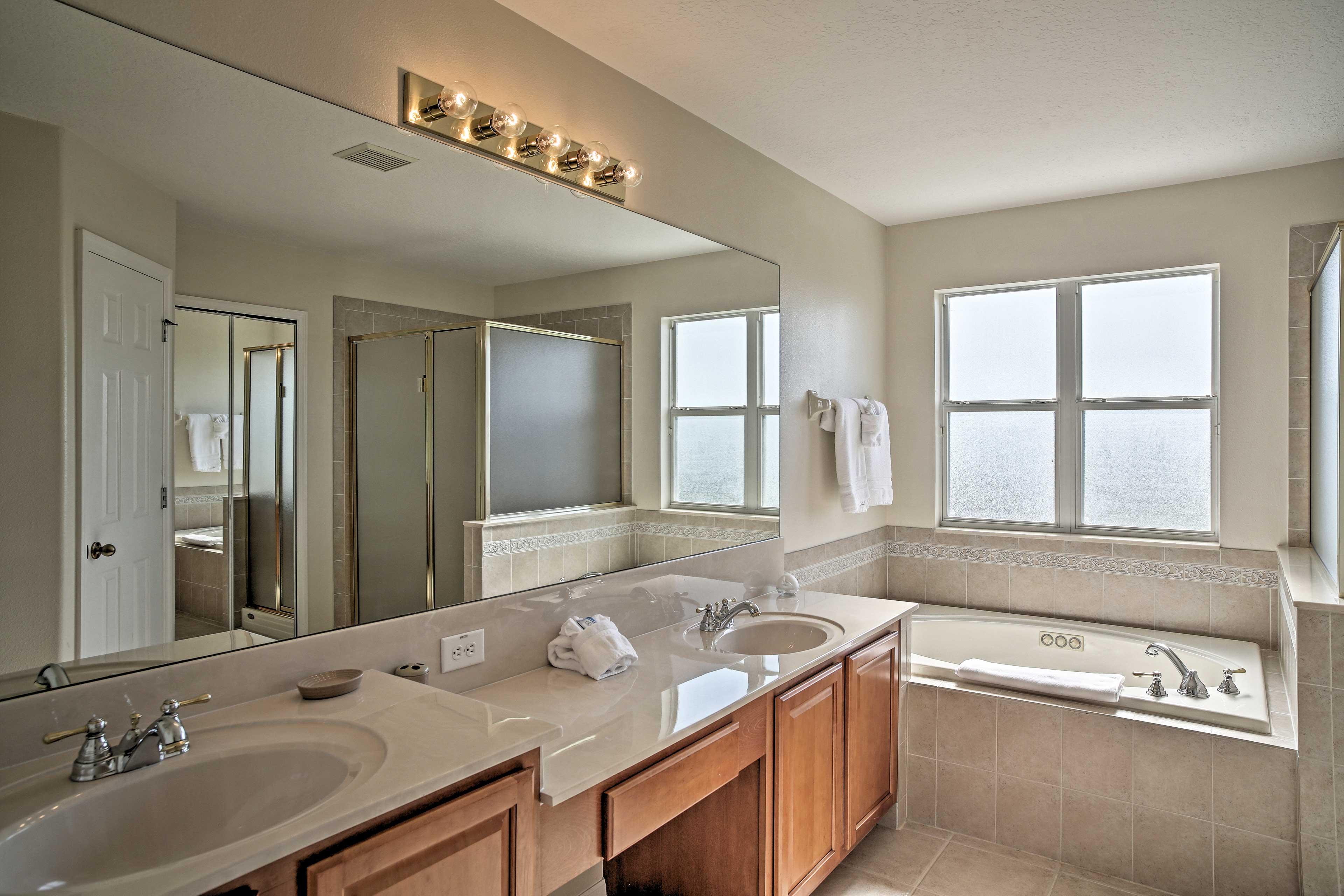 The master bath boasts a soaking tub and walk-in shower.