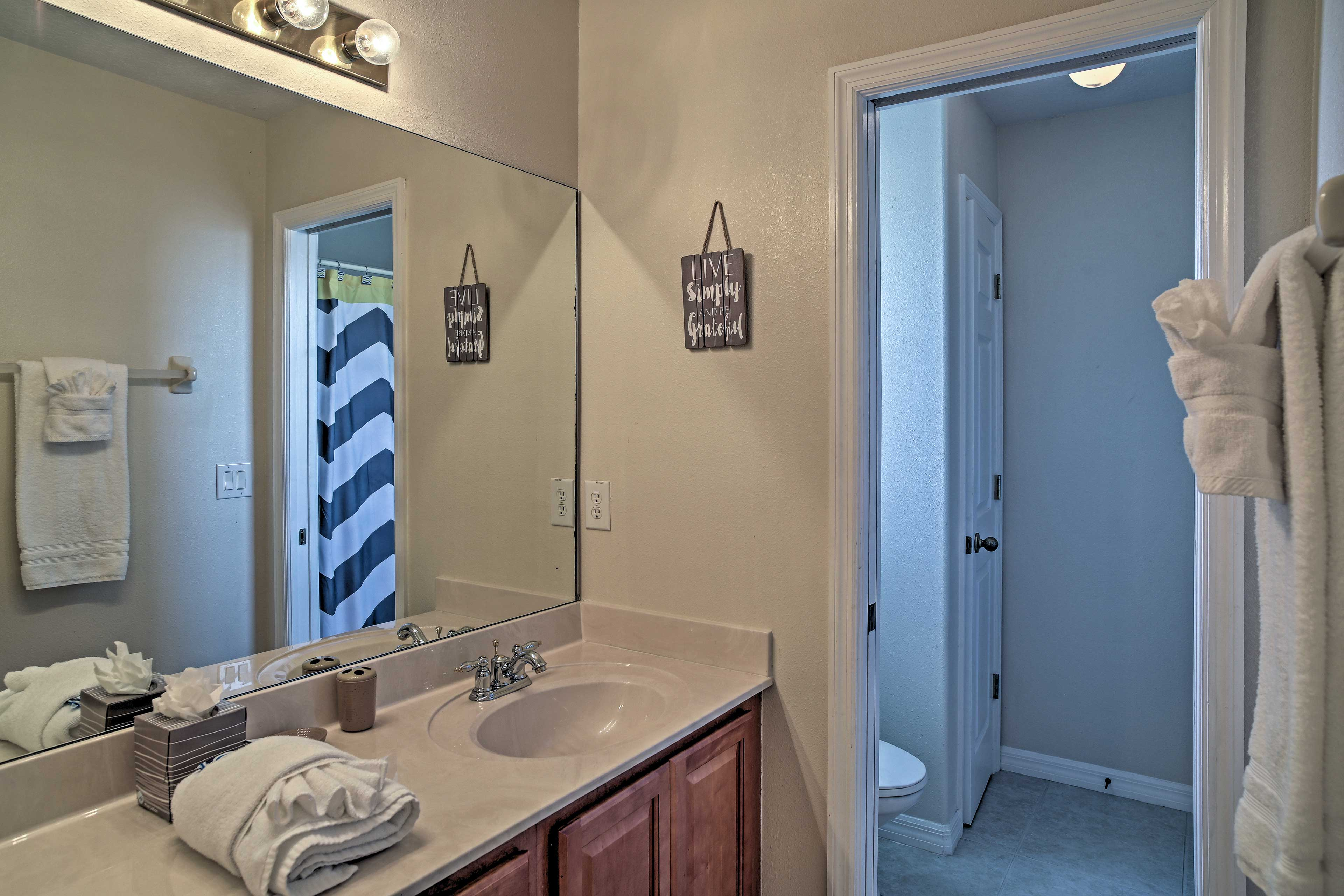 The second bathroom hosts a shower/tub combo.