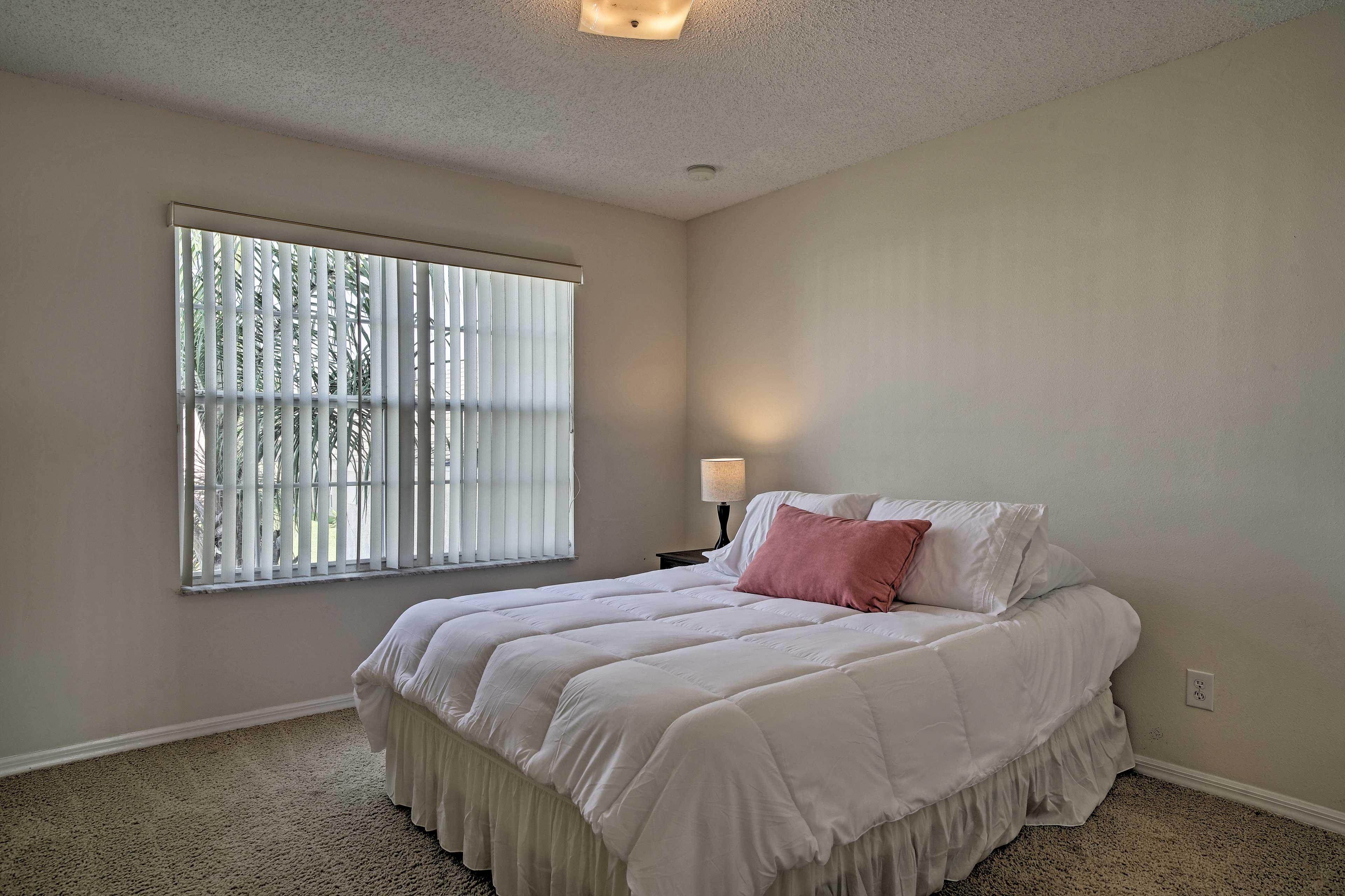Bedroom 4 hosts a cozy queen bed.