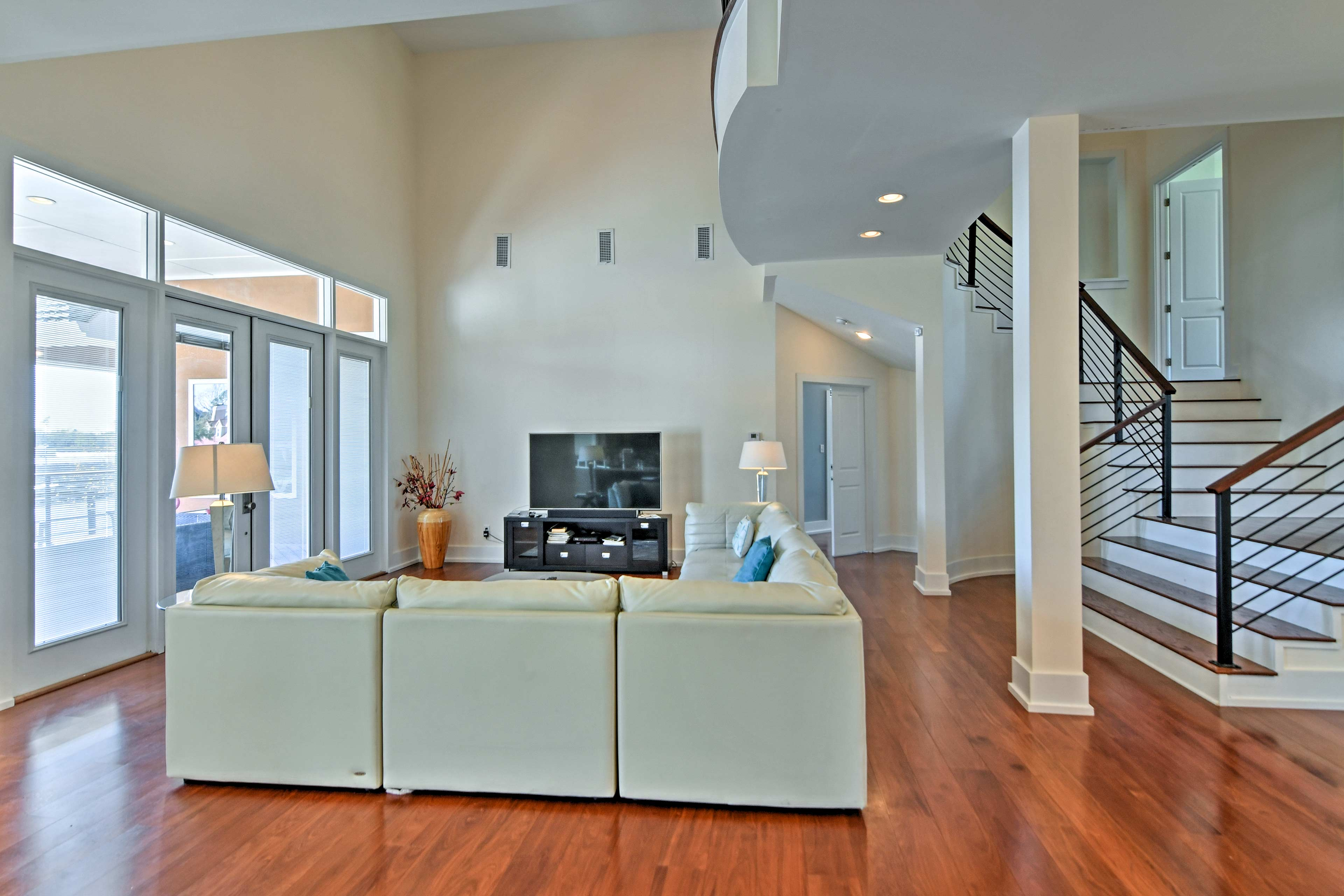 Unwind in the spacious living room with favorite shows on the flat-screen TV.