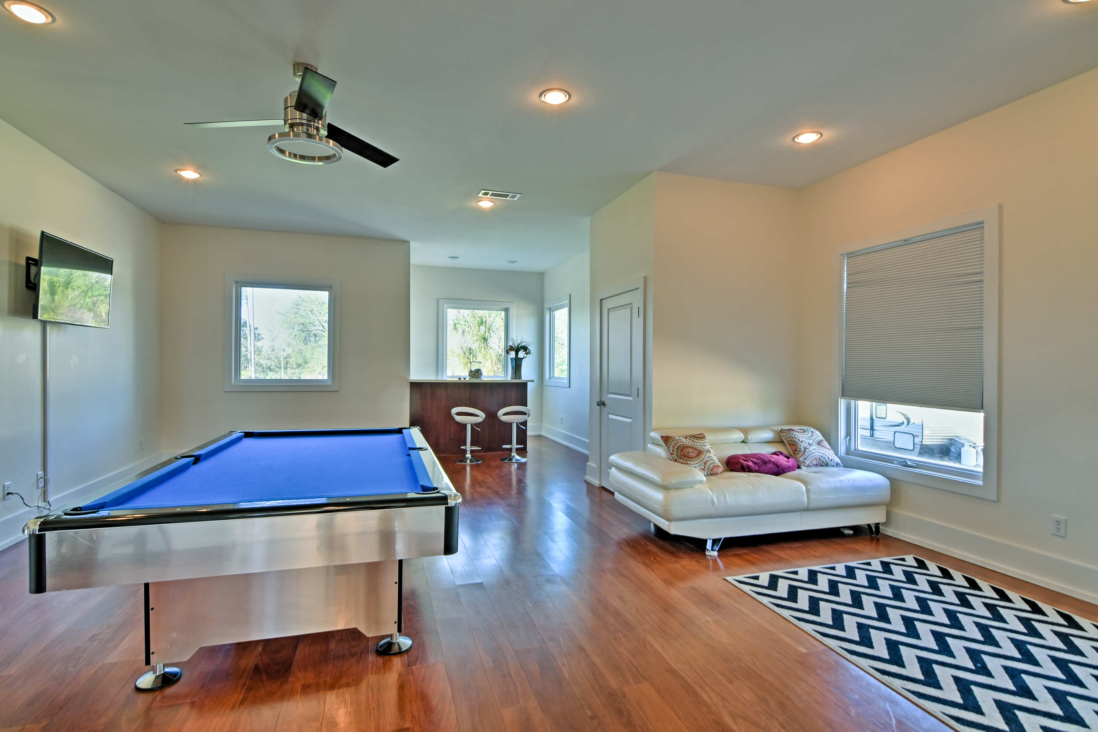 The game room provides a bar and pool table.