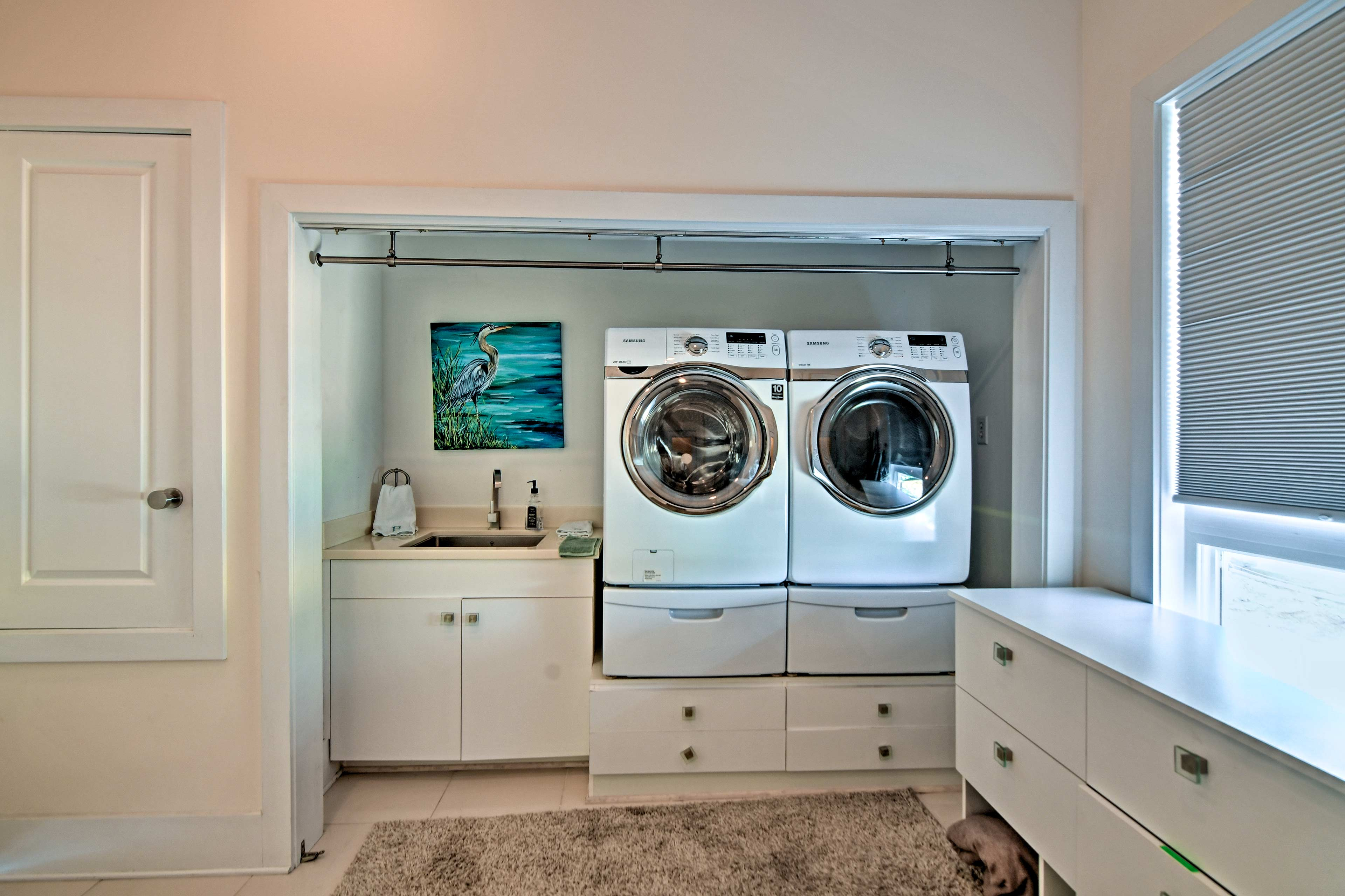 Keep clothes fresh with this fully outfitted laundry area.
