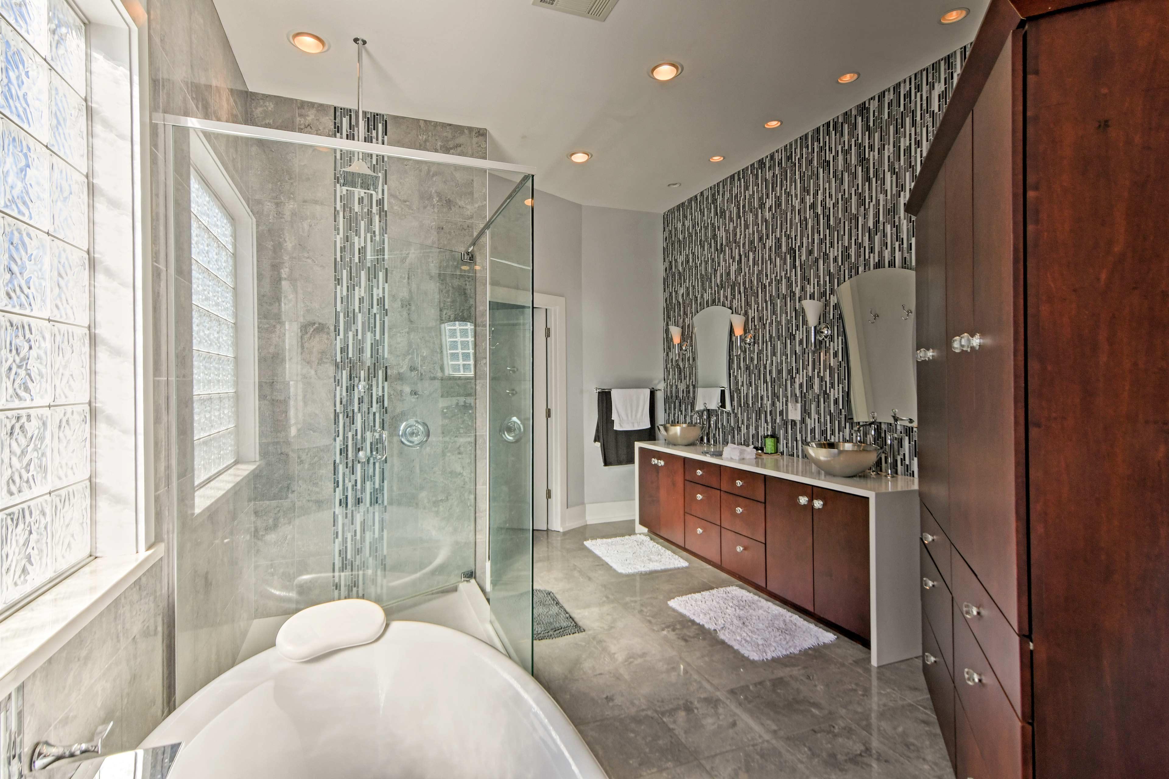 Wash off in the pristine master bathroom.