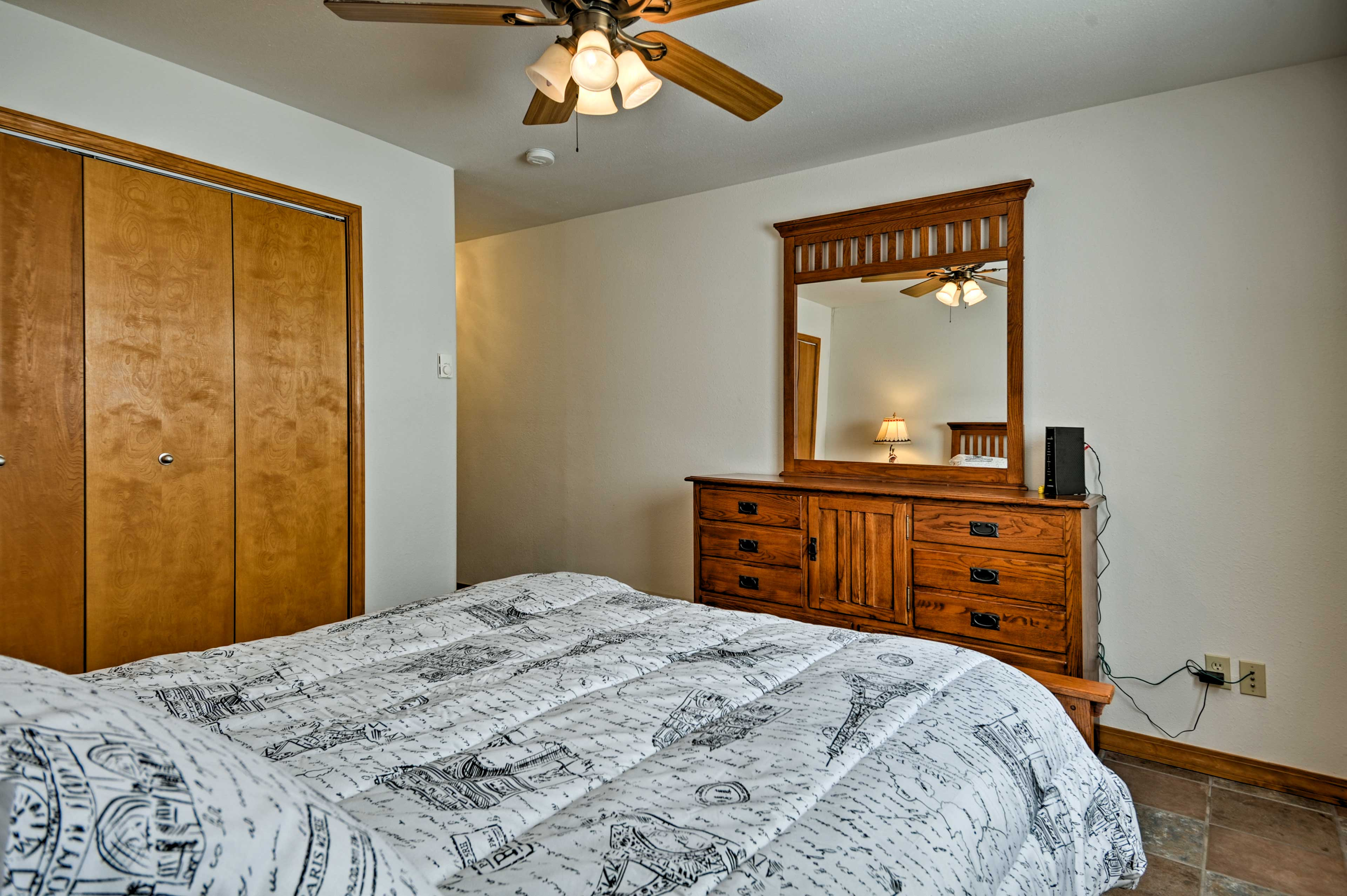 Wood furnishings give all 4 bedrooms a home-like feel.
