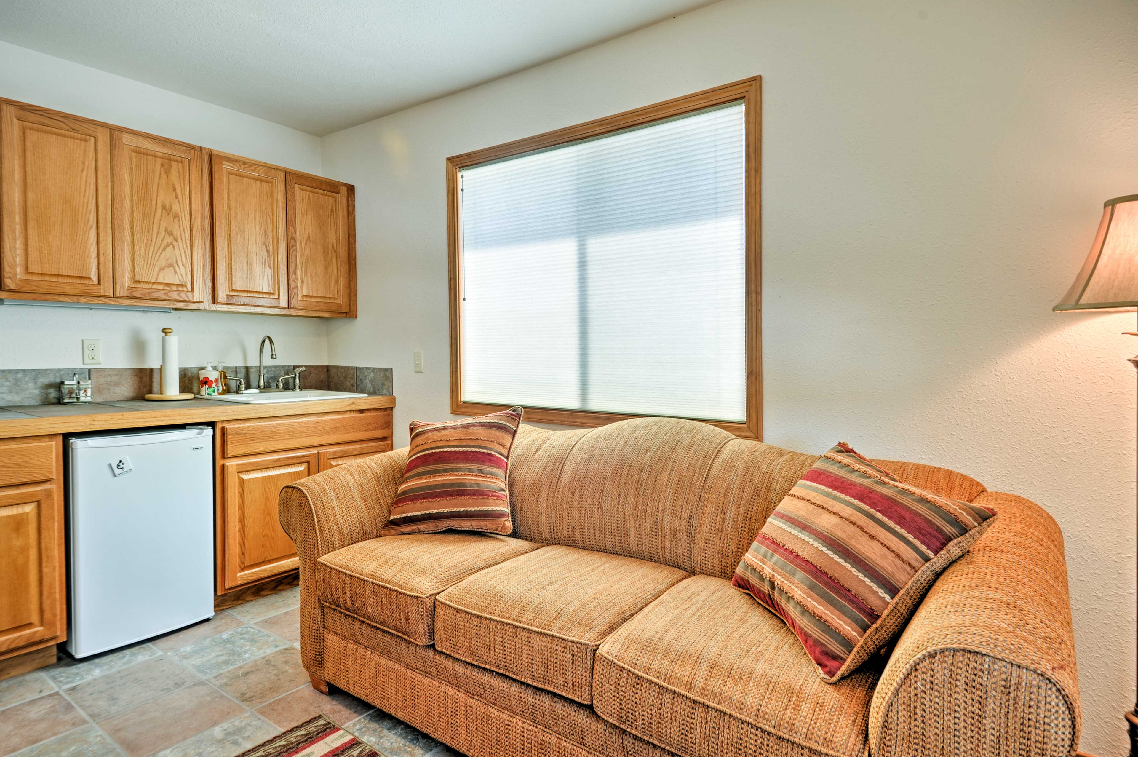 The second living area houses a wet bar, workspace and sleeper sofa.