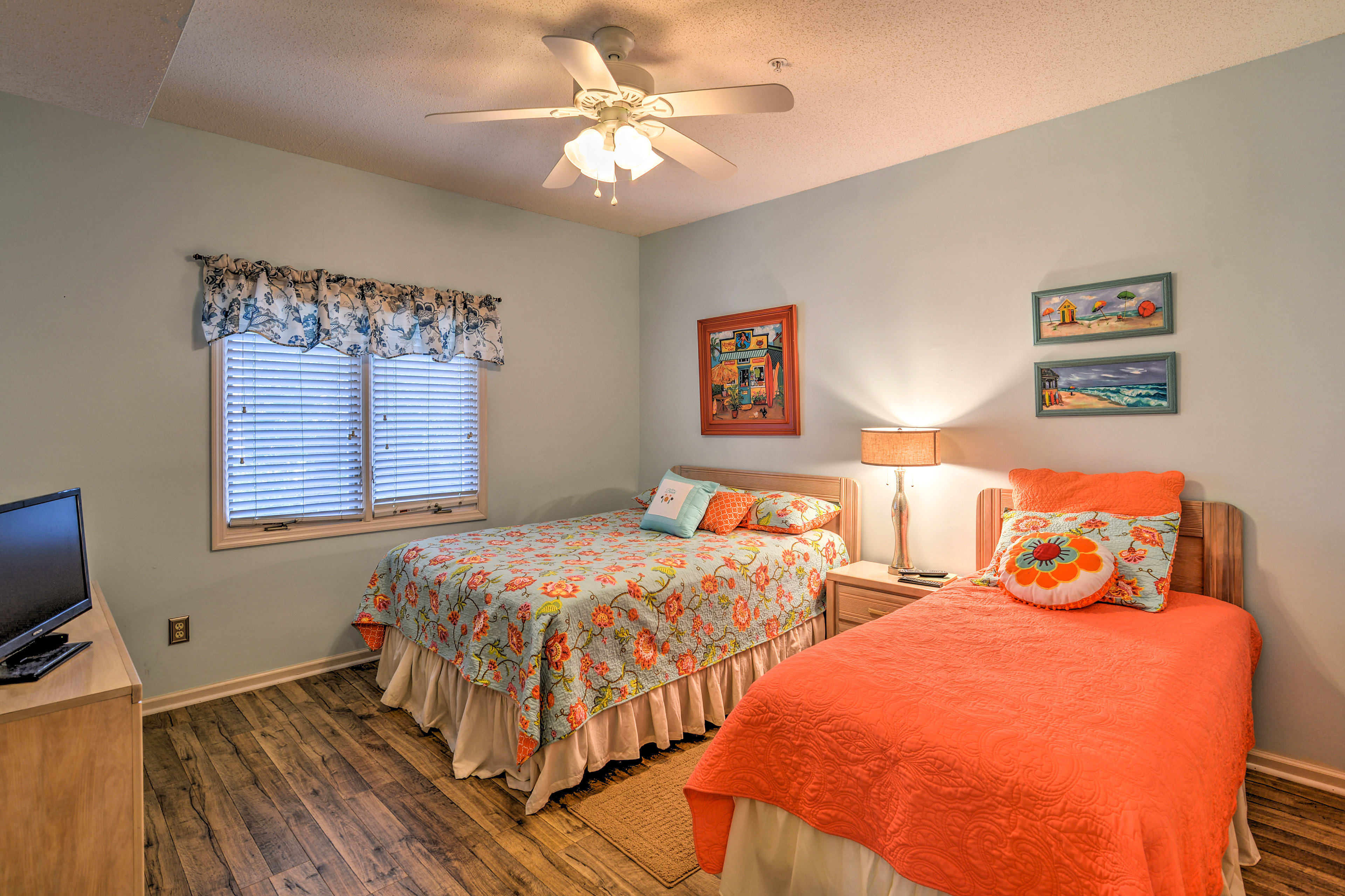 Bedroom 2 boasts a queen and twin bed.