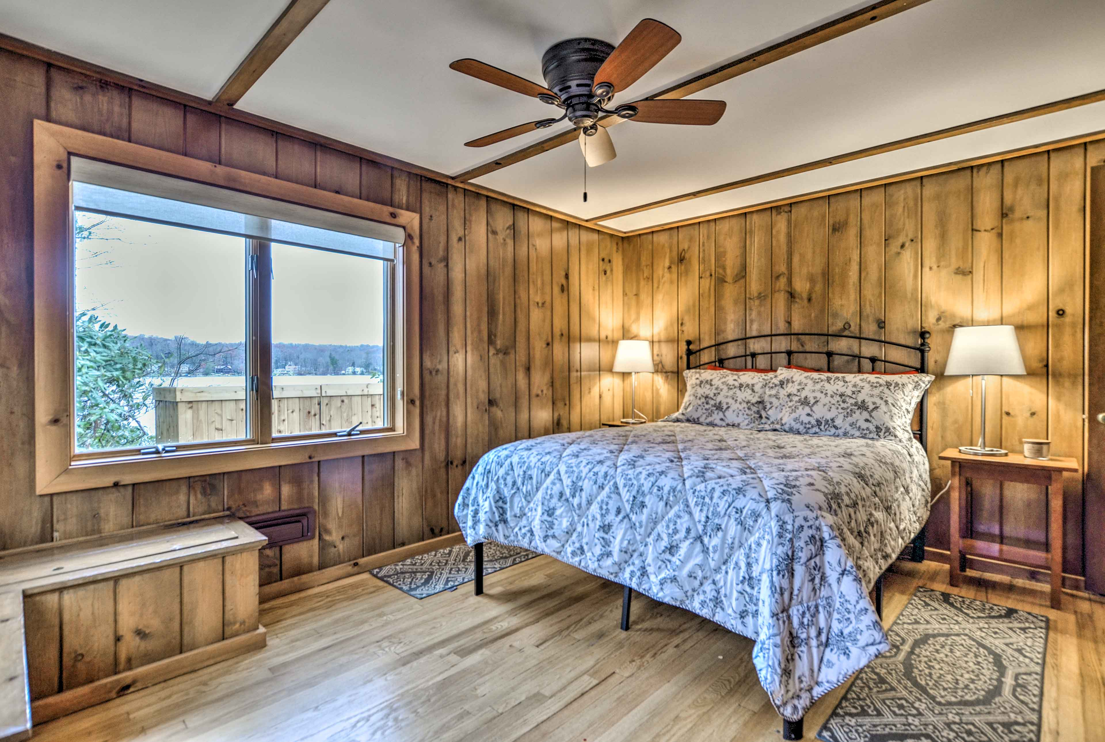 Fall into this queen bed after a day of canoeing on the lake.