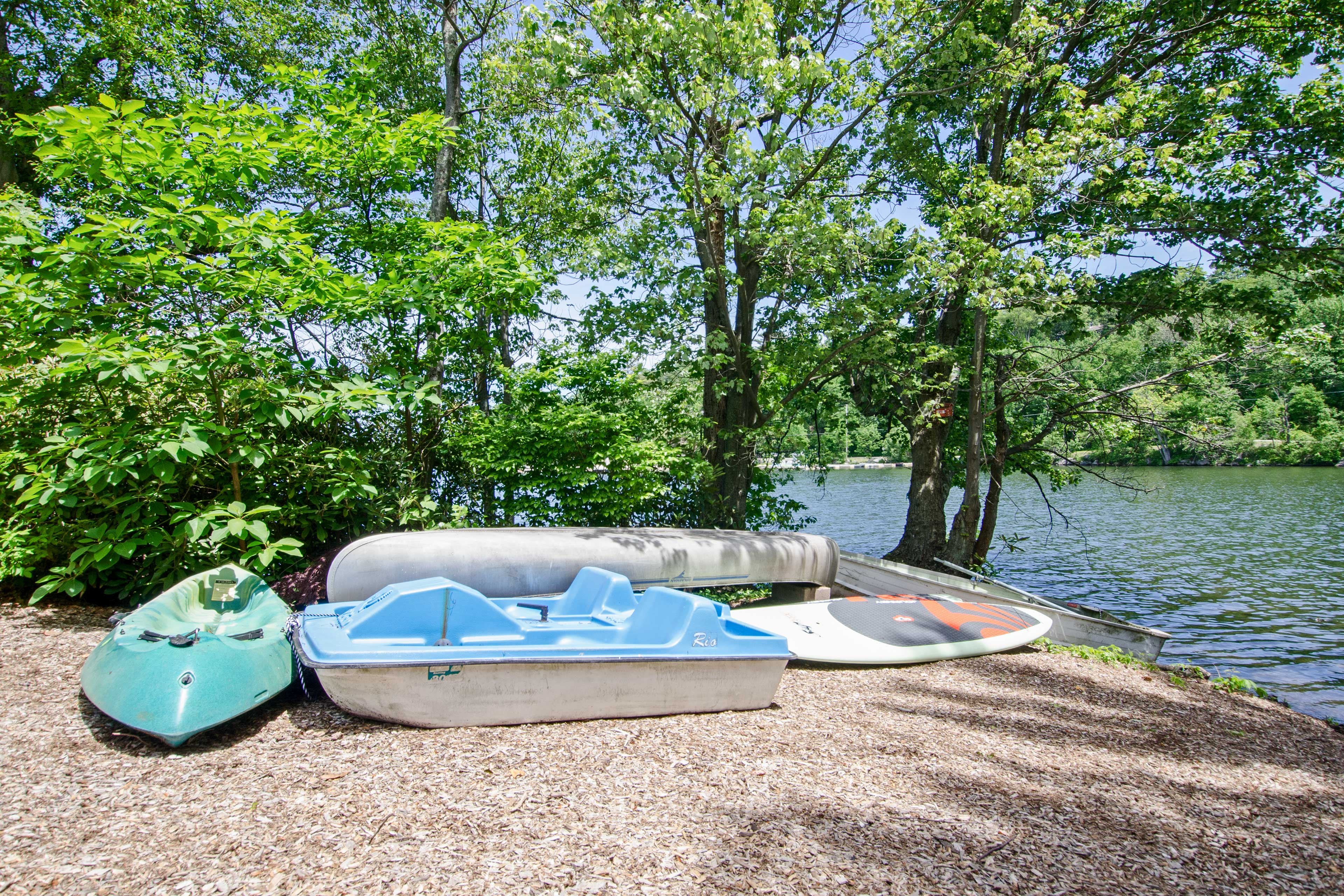 A canoe, sit-on-top kayak, stand-up paddle boards and more are provided.