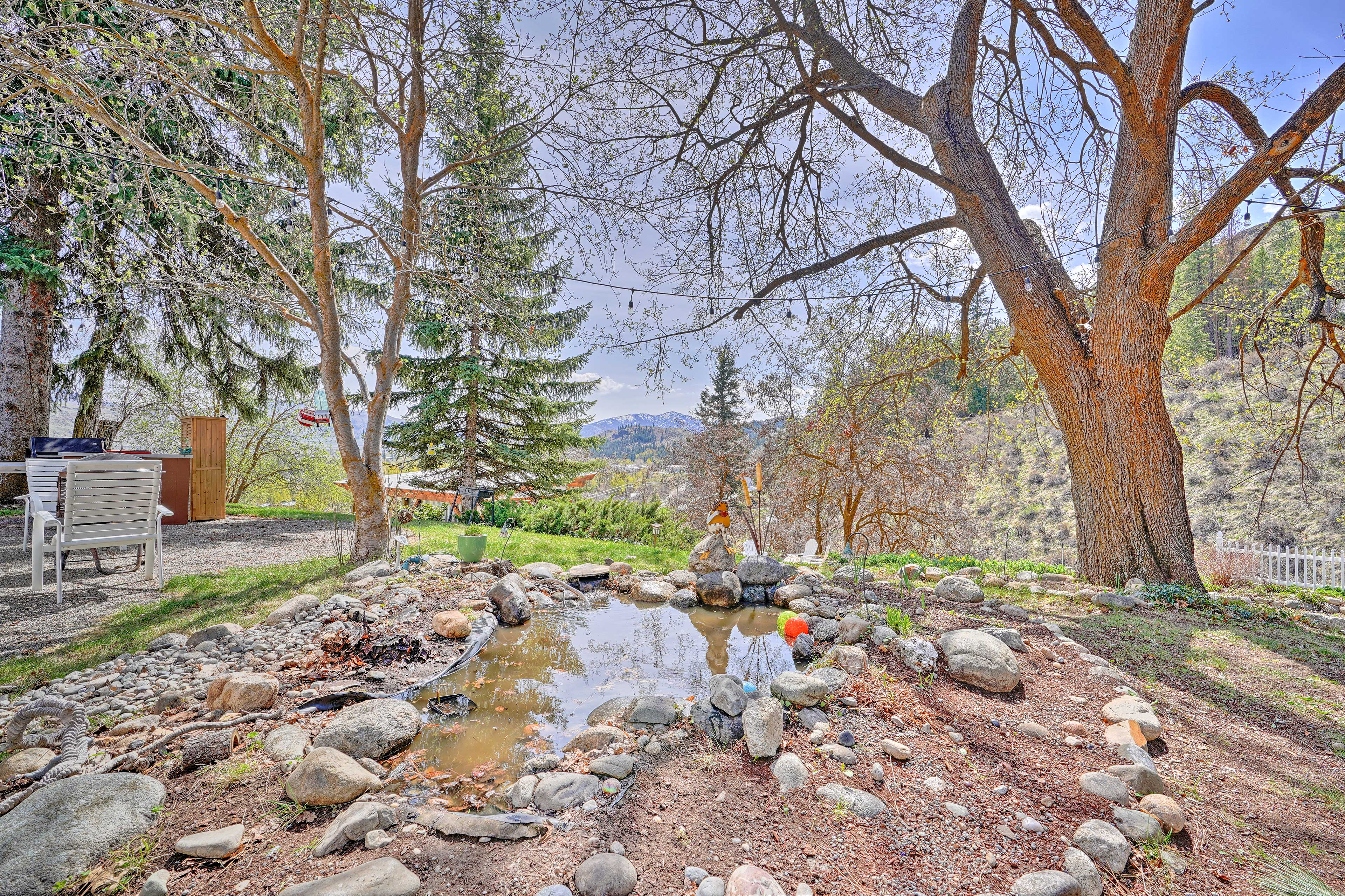 Sit by the home's little pond and listen to the wind rustling through the trees.