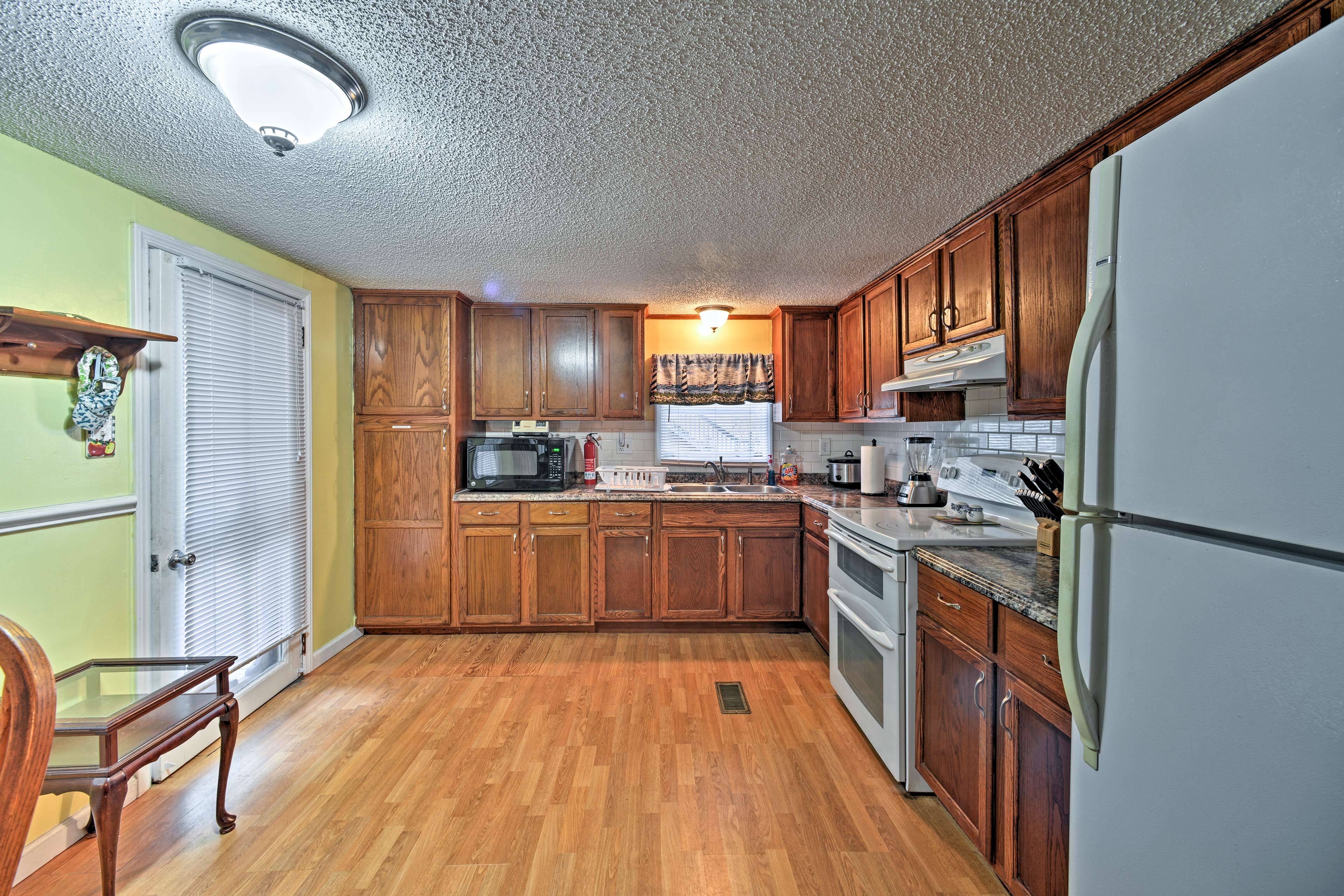 The kitchen comes fully equipped with everything you need for home-cooking.