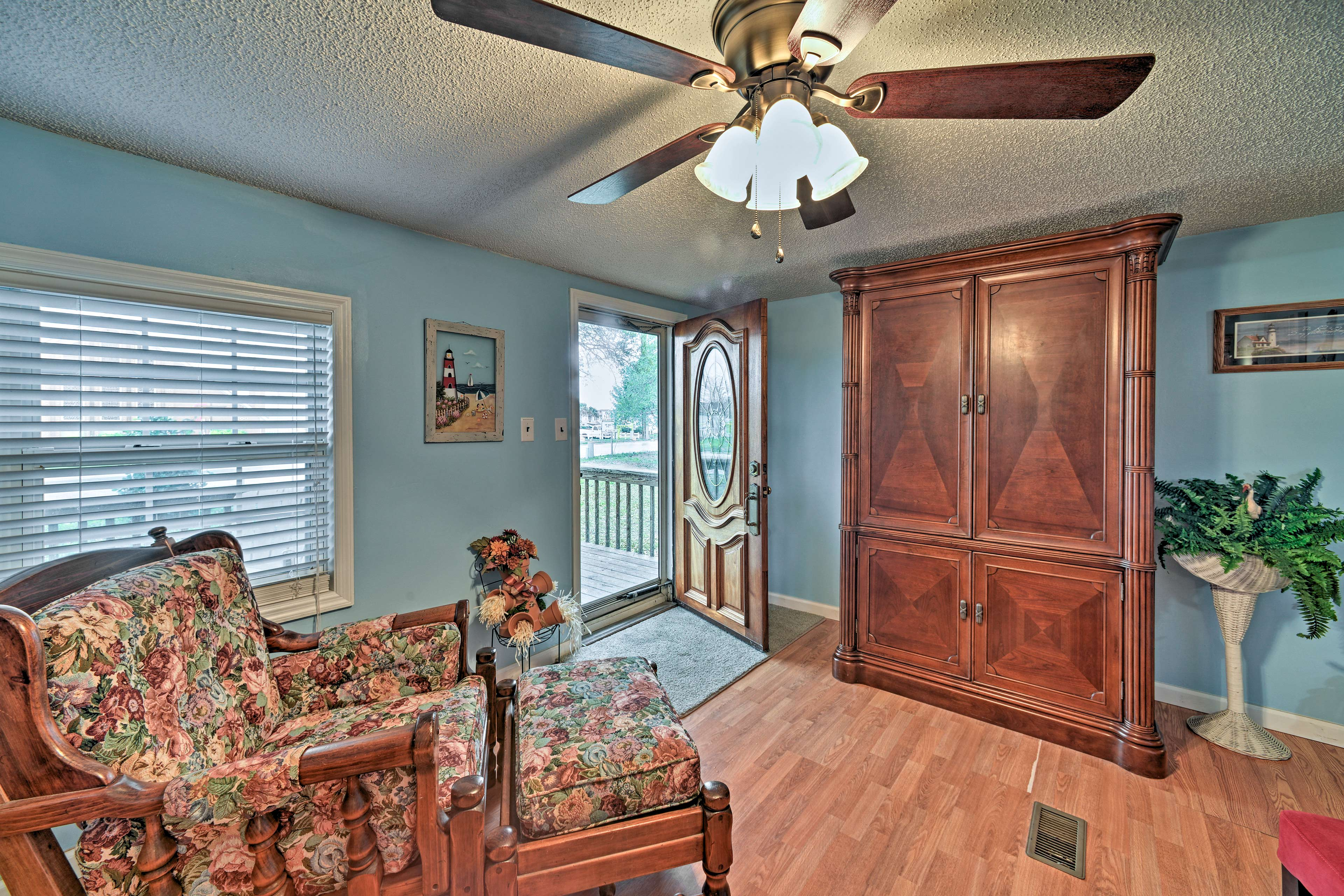 The formal living room welcomes you back home daily.