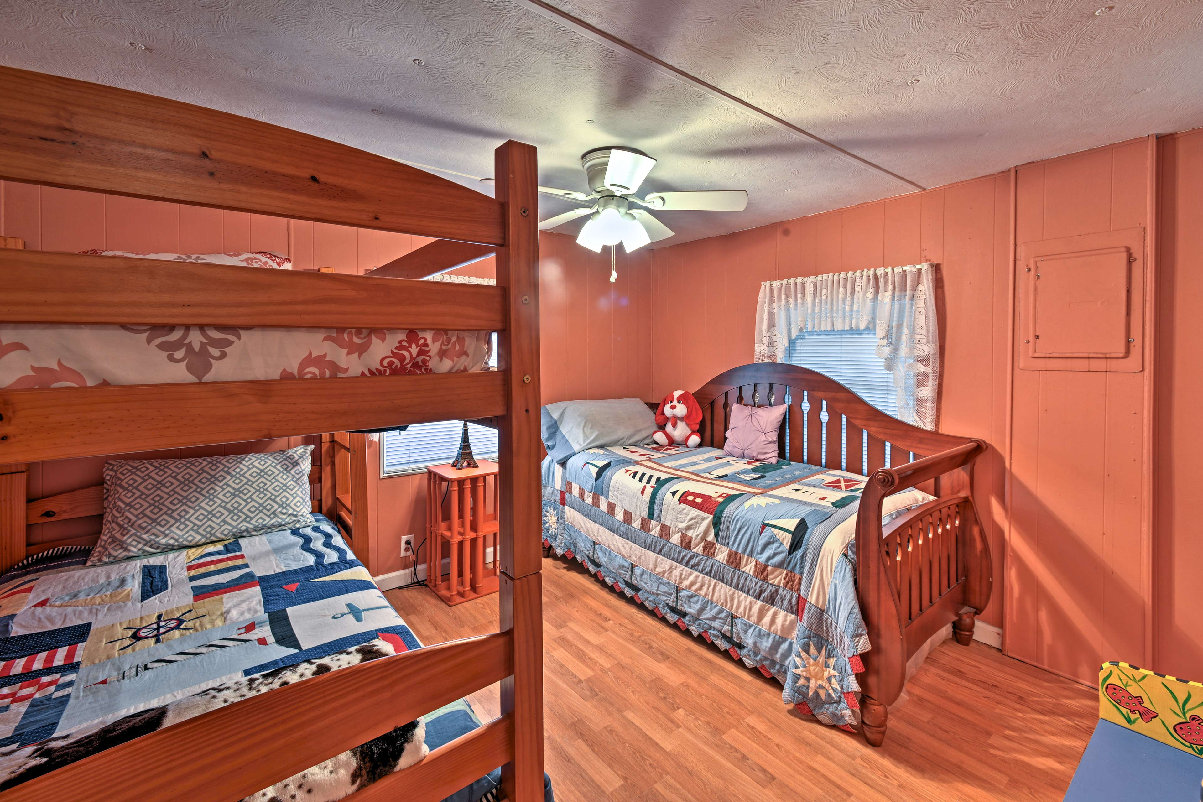 The third bedroom is furnished with a twin-over-twin bunk bed and twin daybed.