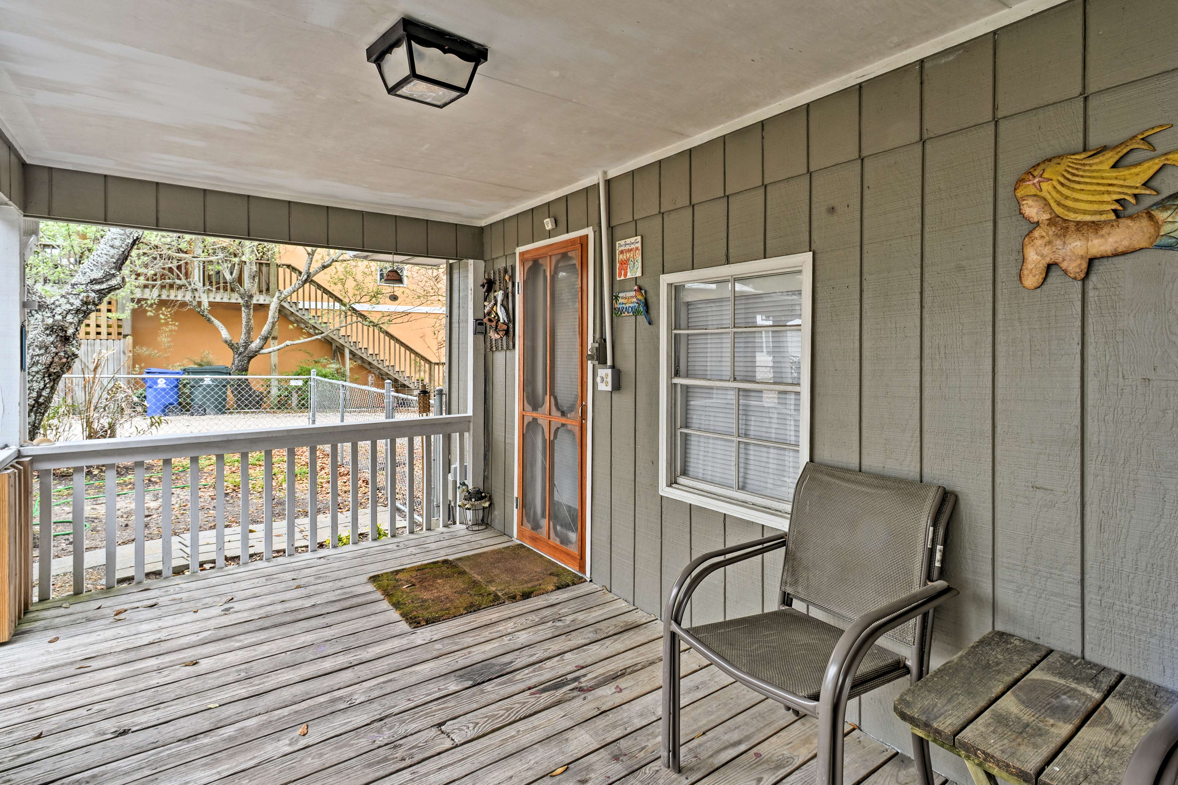 Unwind on the furnished front porch with a refreshing beverage.