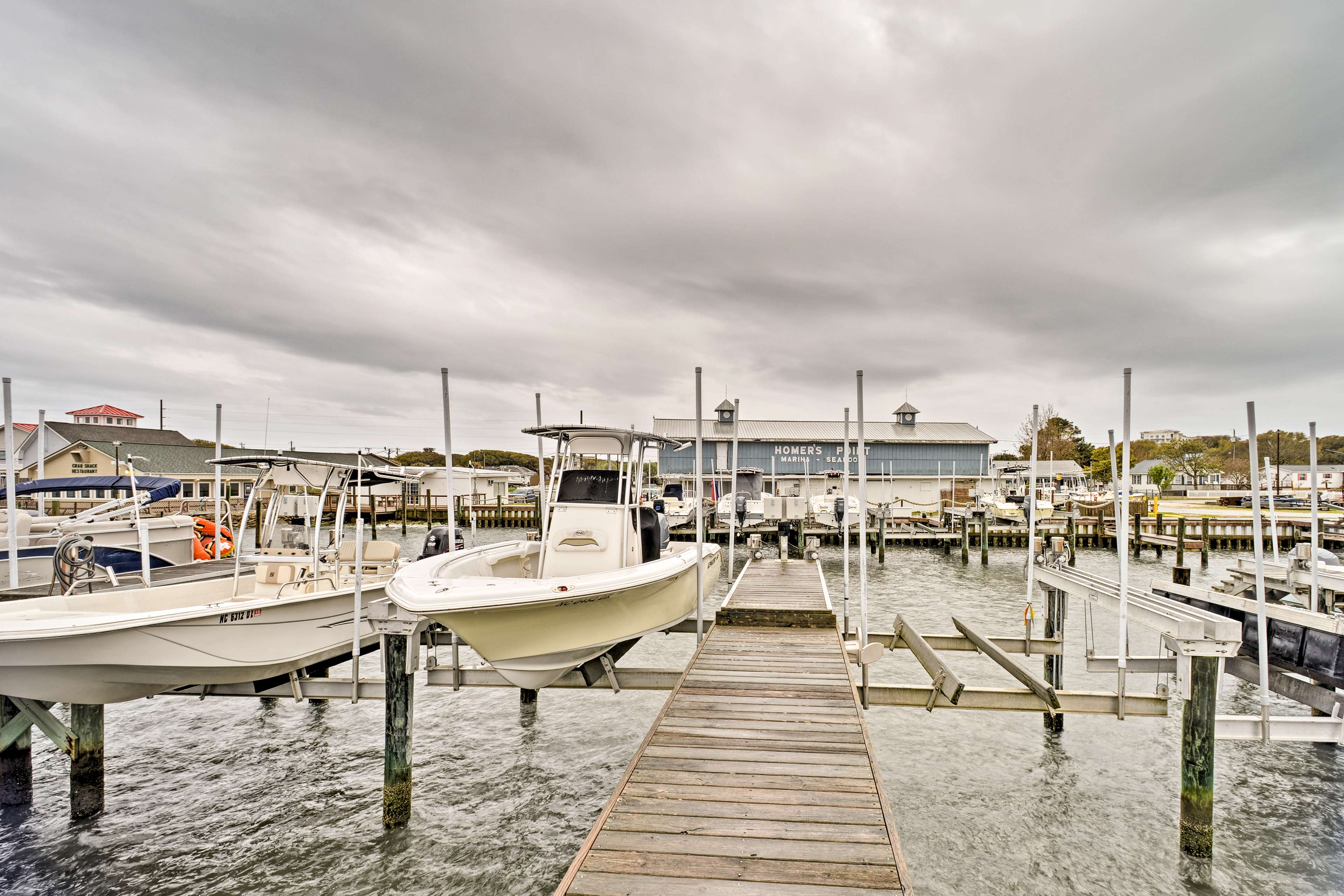 The home features a prime location just a short walk from the marina and beach!