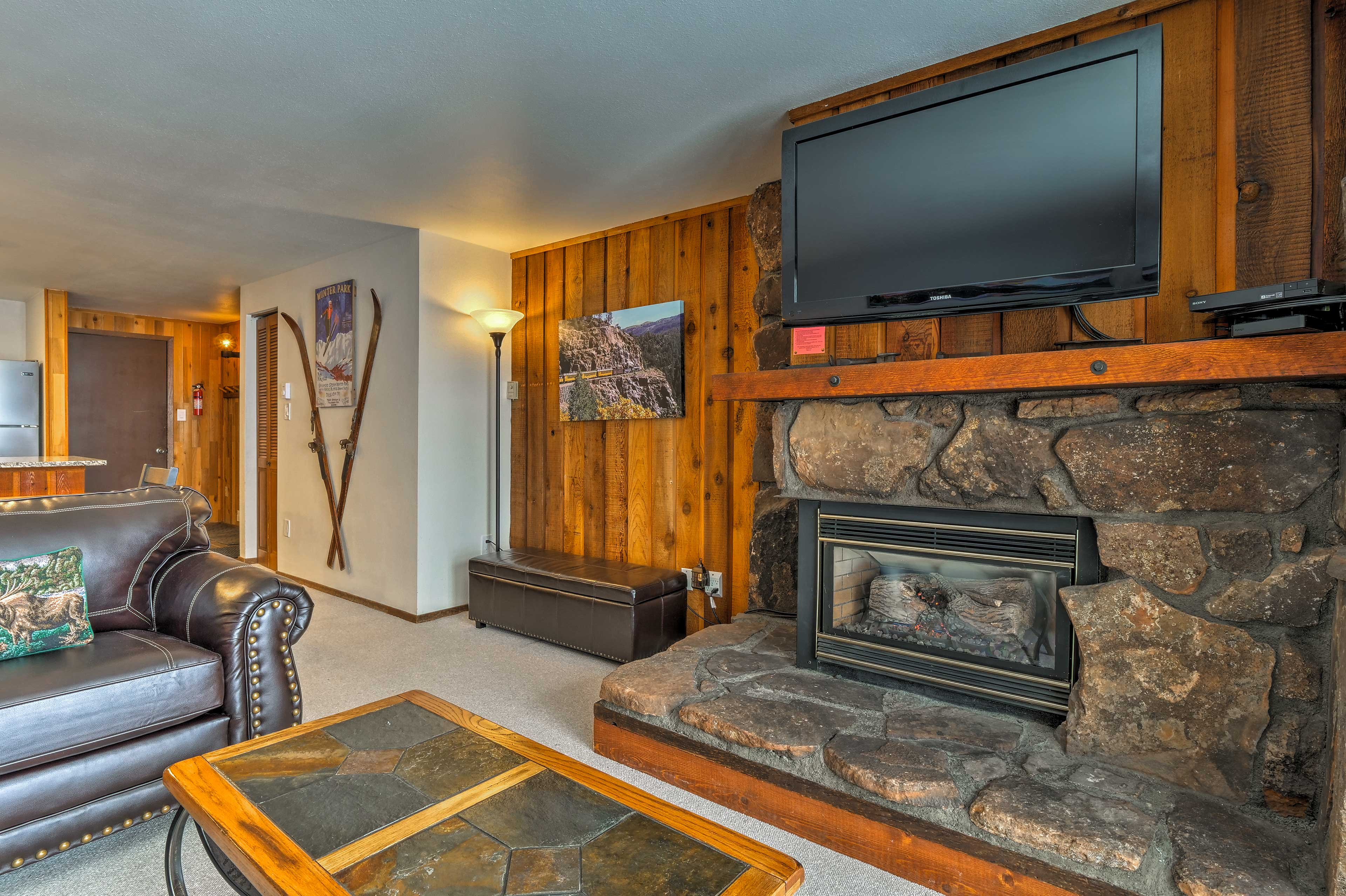Keep warm by the gas fireplace while watching the flat-screen cable TV.