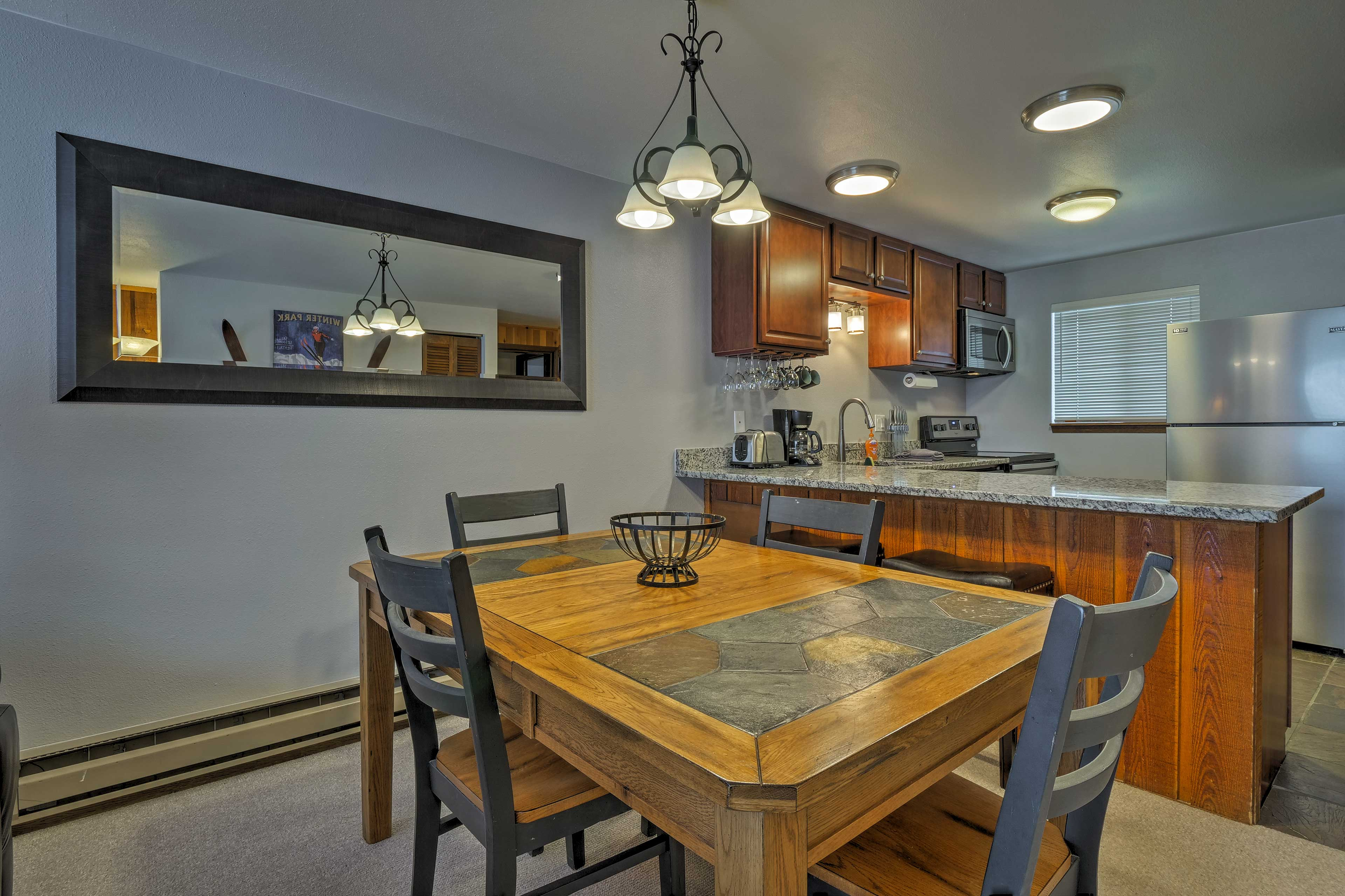 Feast on a tasty meal at the 4-person dining table.