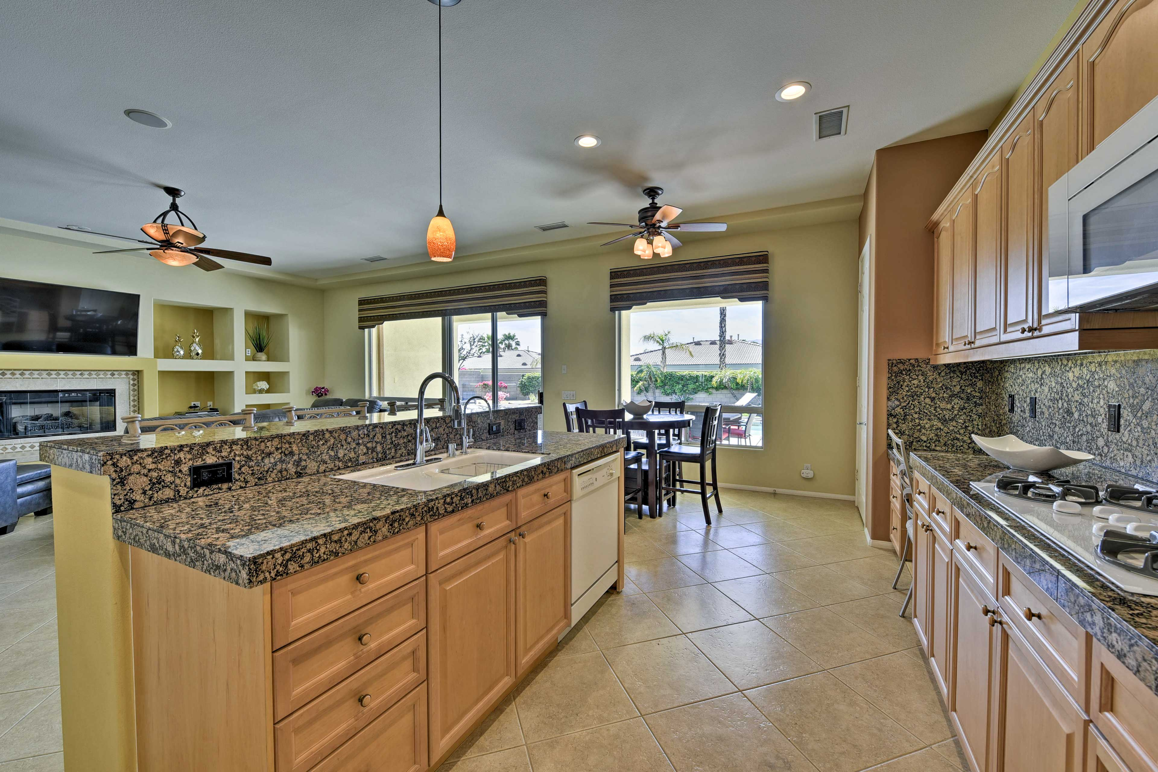 This gourmet kitchen is adorned with granite countertops and modern appliances.