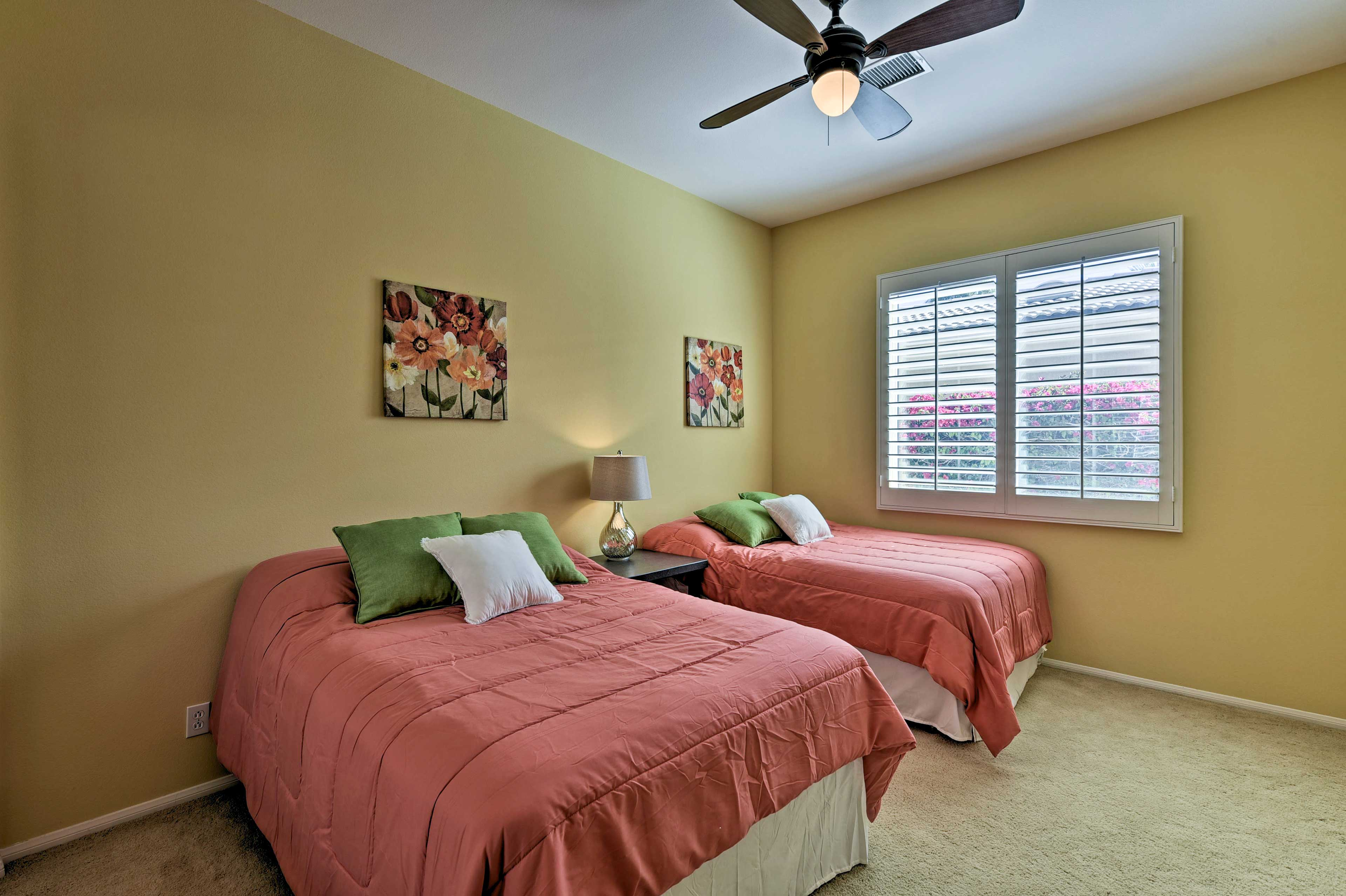 This vibrantly hued space has 2 full beds.