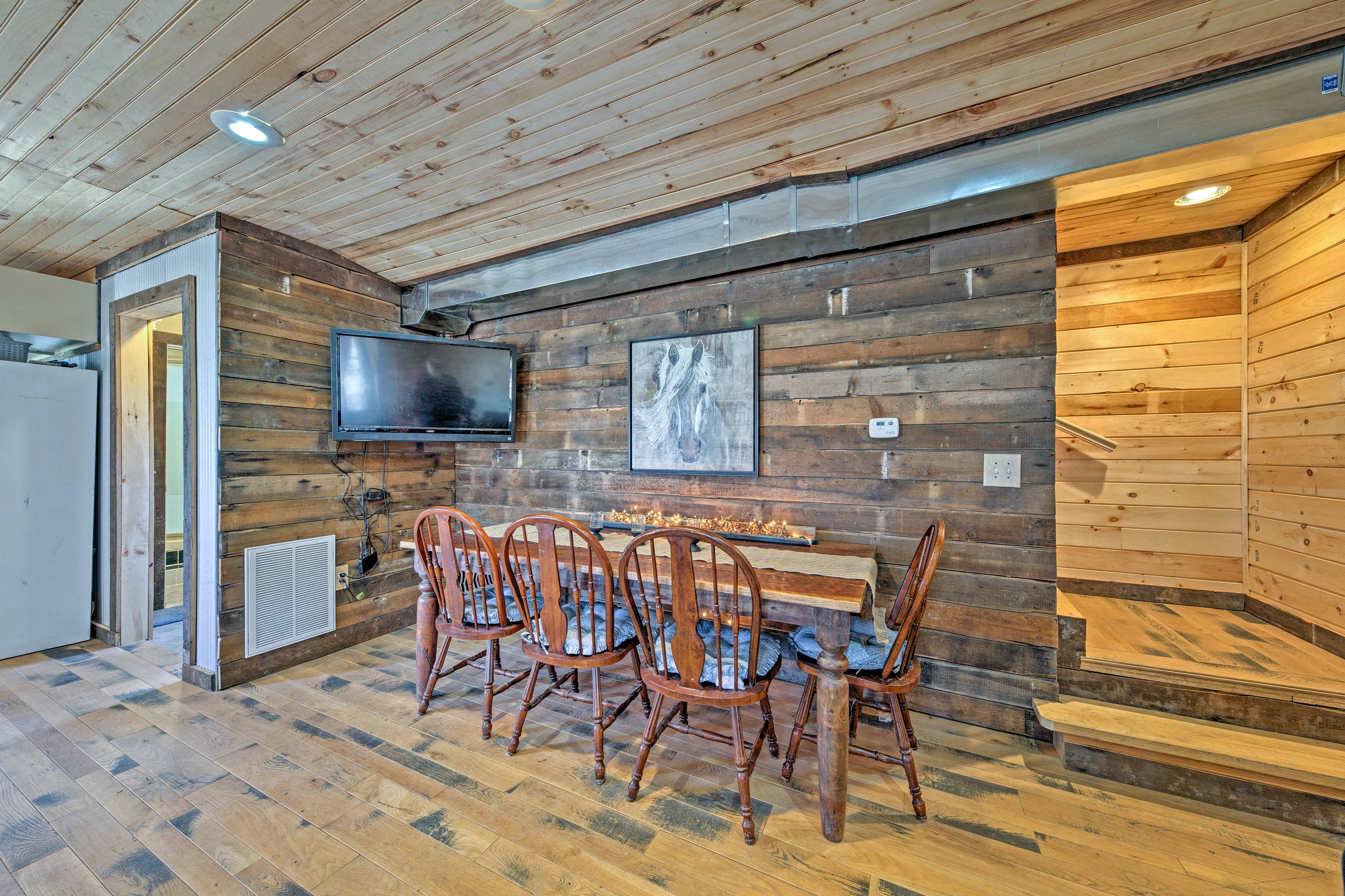 Enjoy watching TV while you dine at the long 8-person table.
