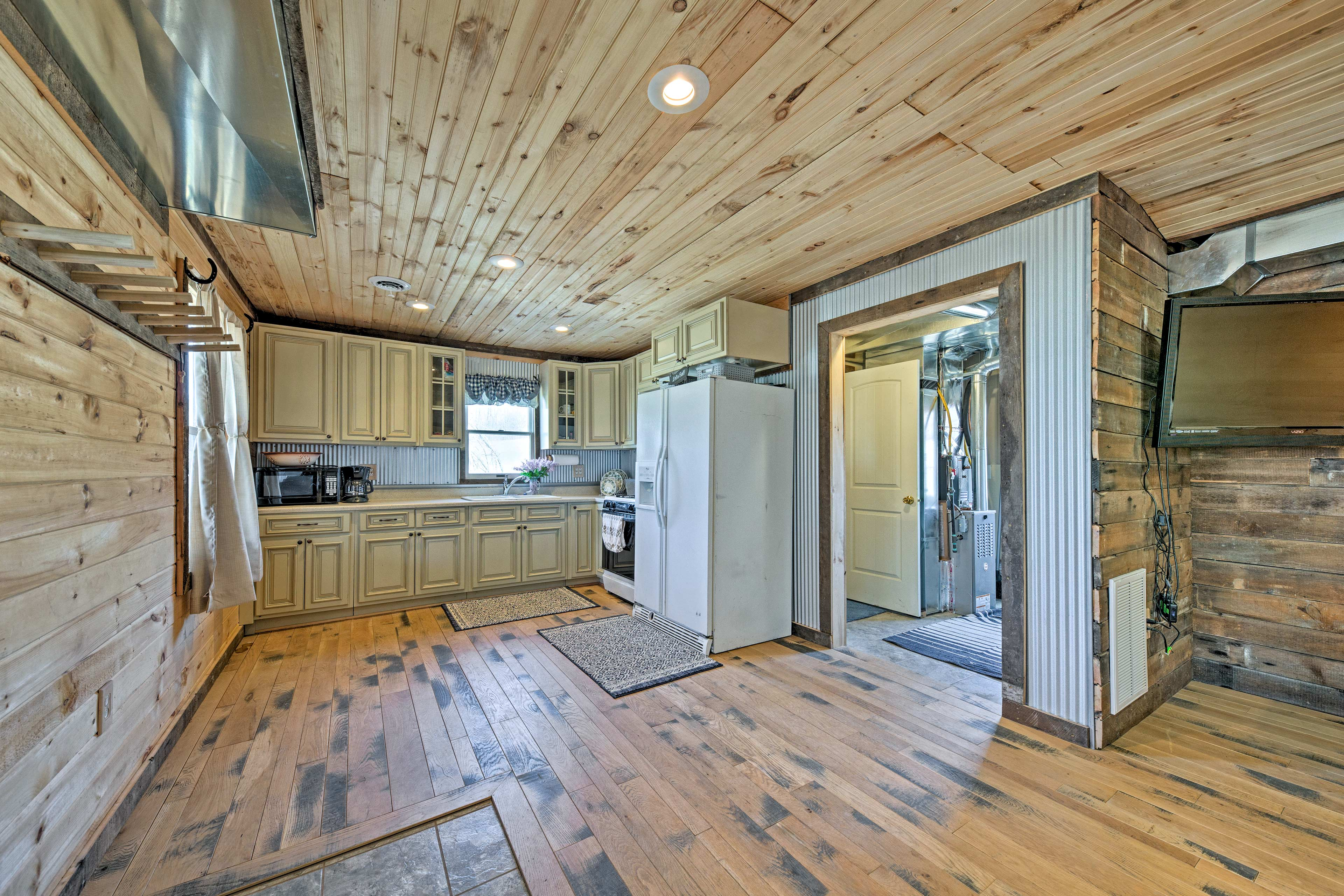 Wood paneled ceilings, walls, and floors exude rustic elegance.