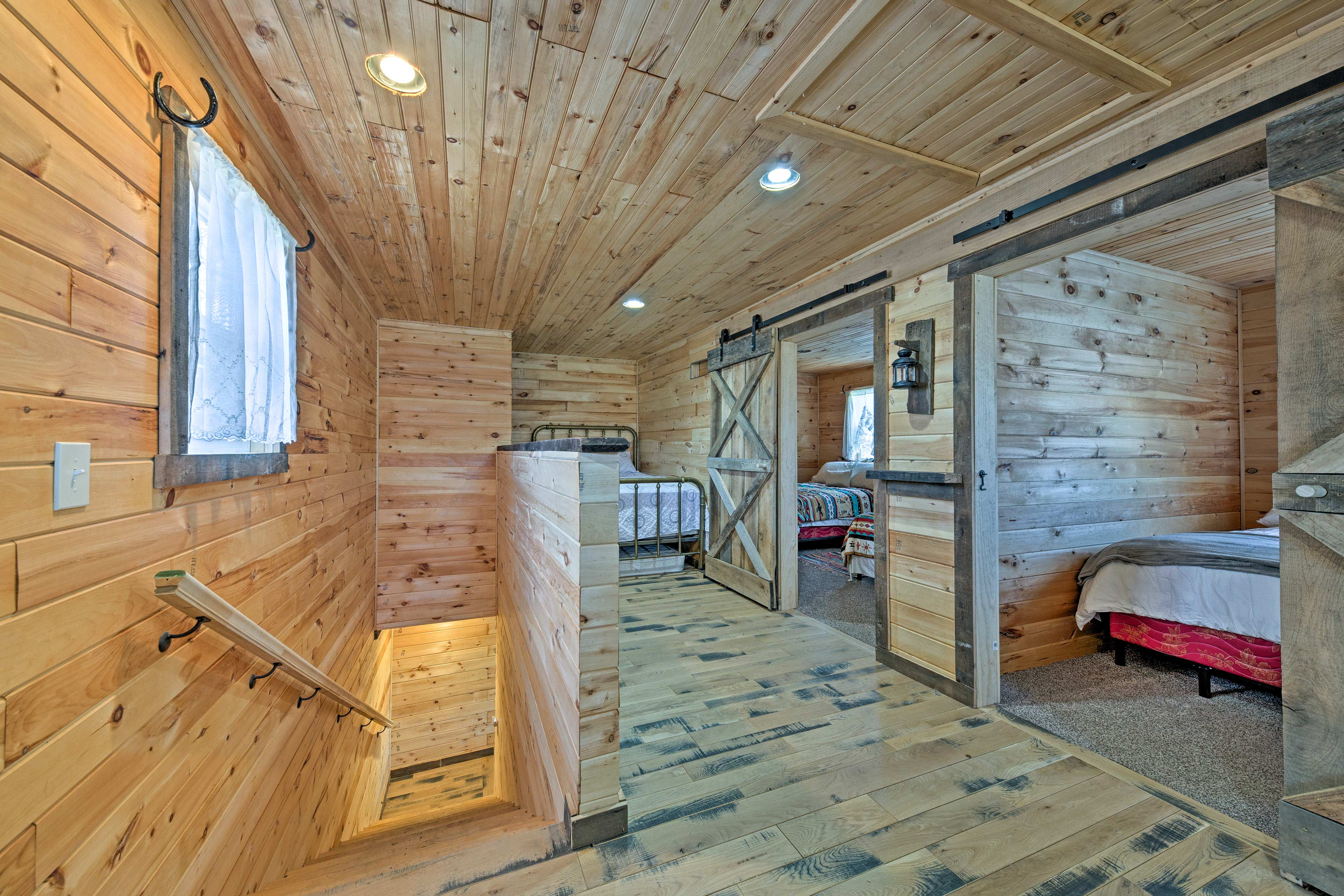 The loft is home to a full-sized bed and 2 twin beds.