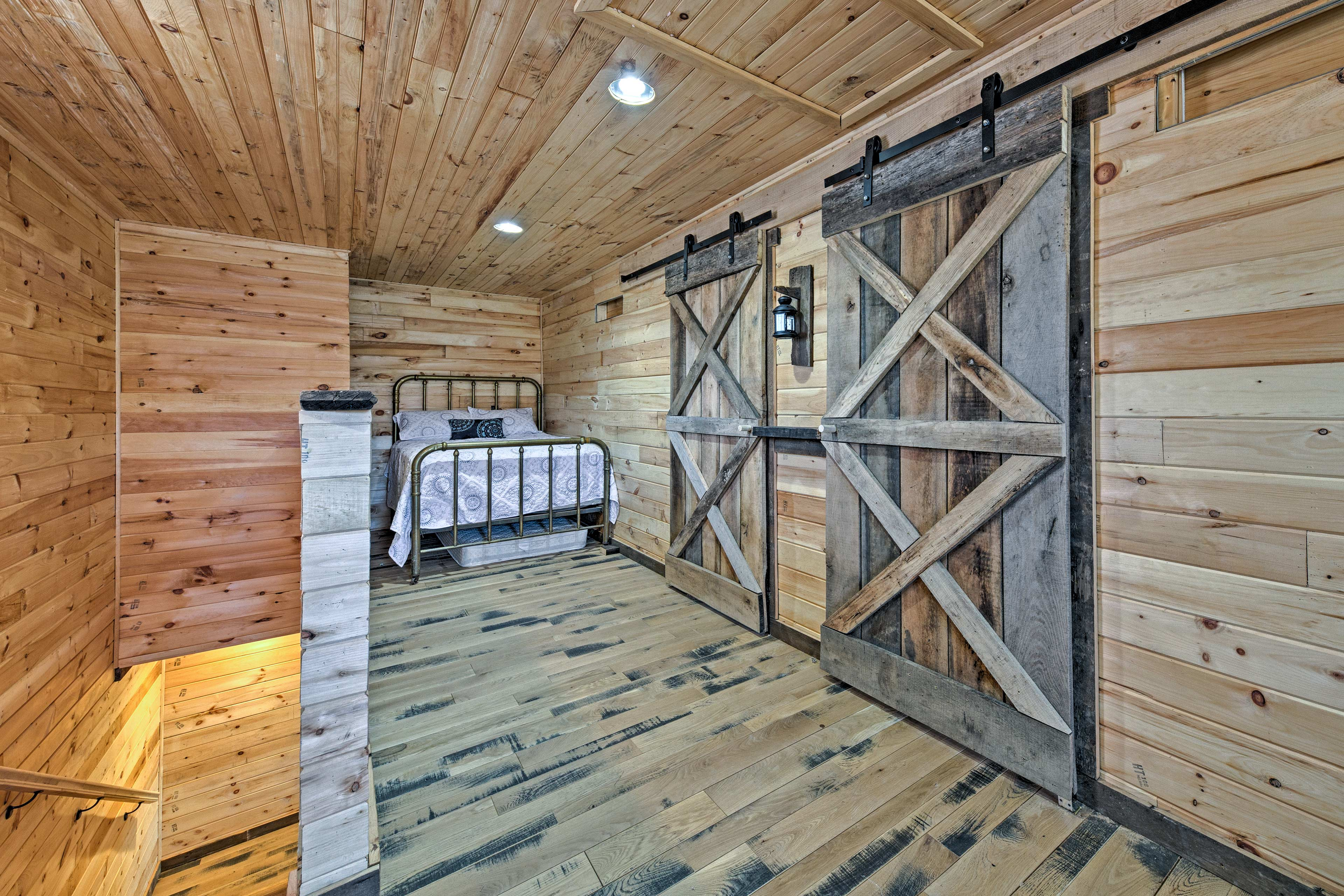 Each bedroom is given privacy with a beautiful sliding barn door.
