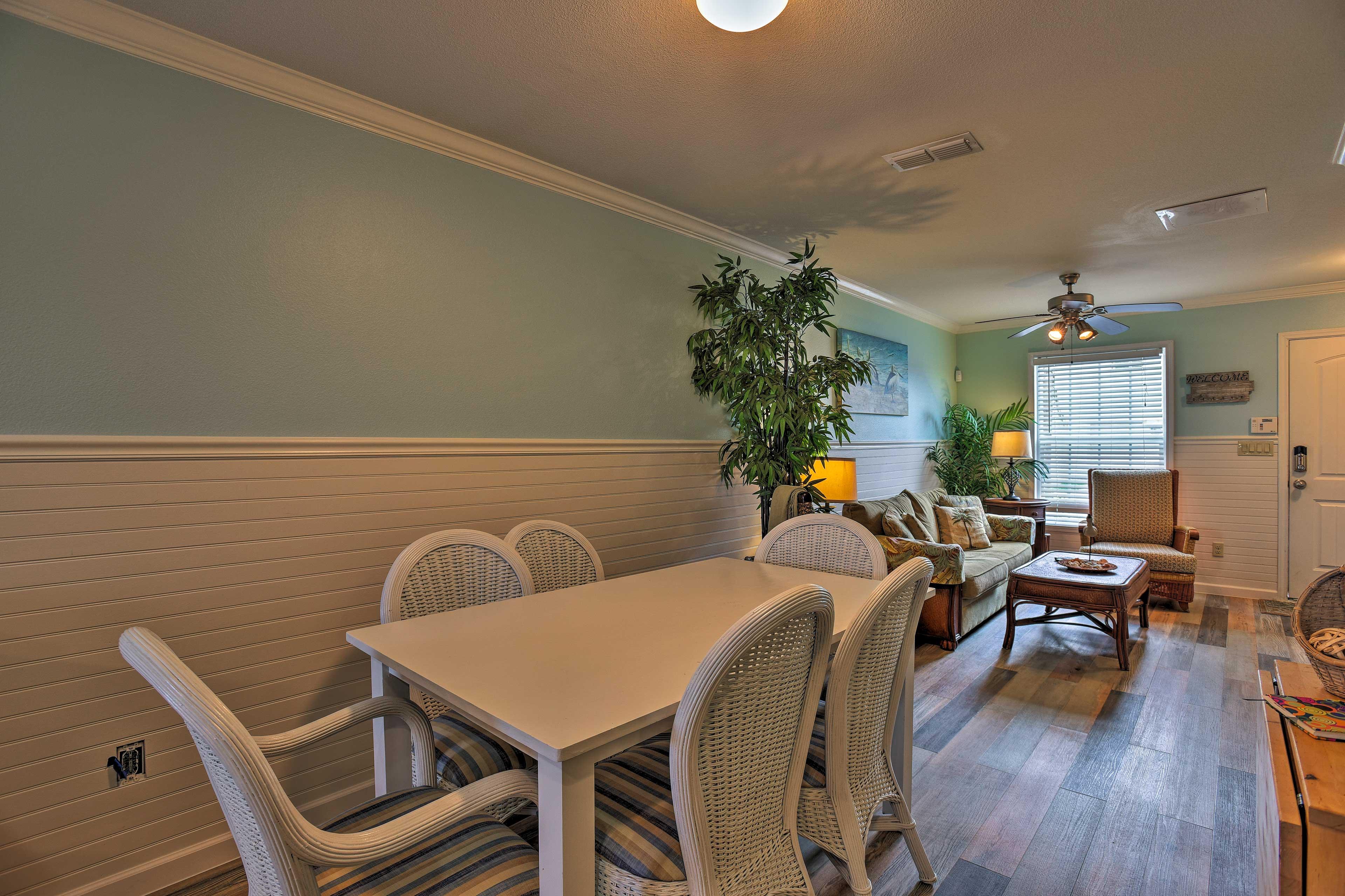 Bright blue walls and sleek hardwood floors highlight the living area.