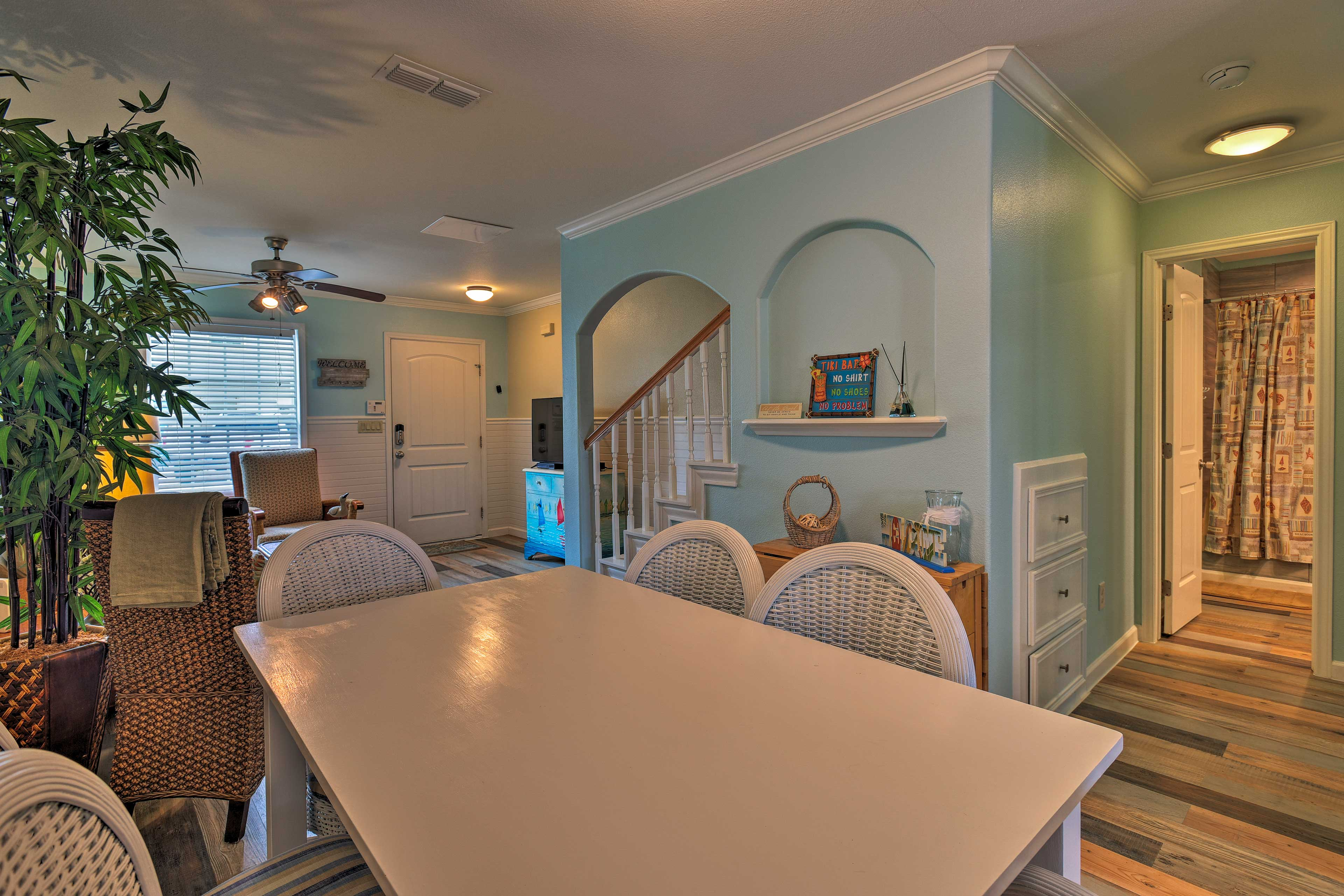 The main level encompasses the living room, dining area and kitchen.