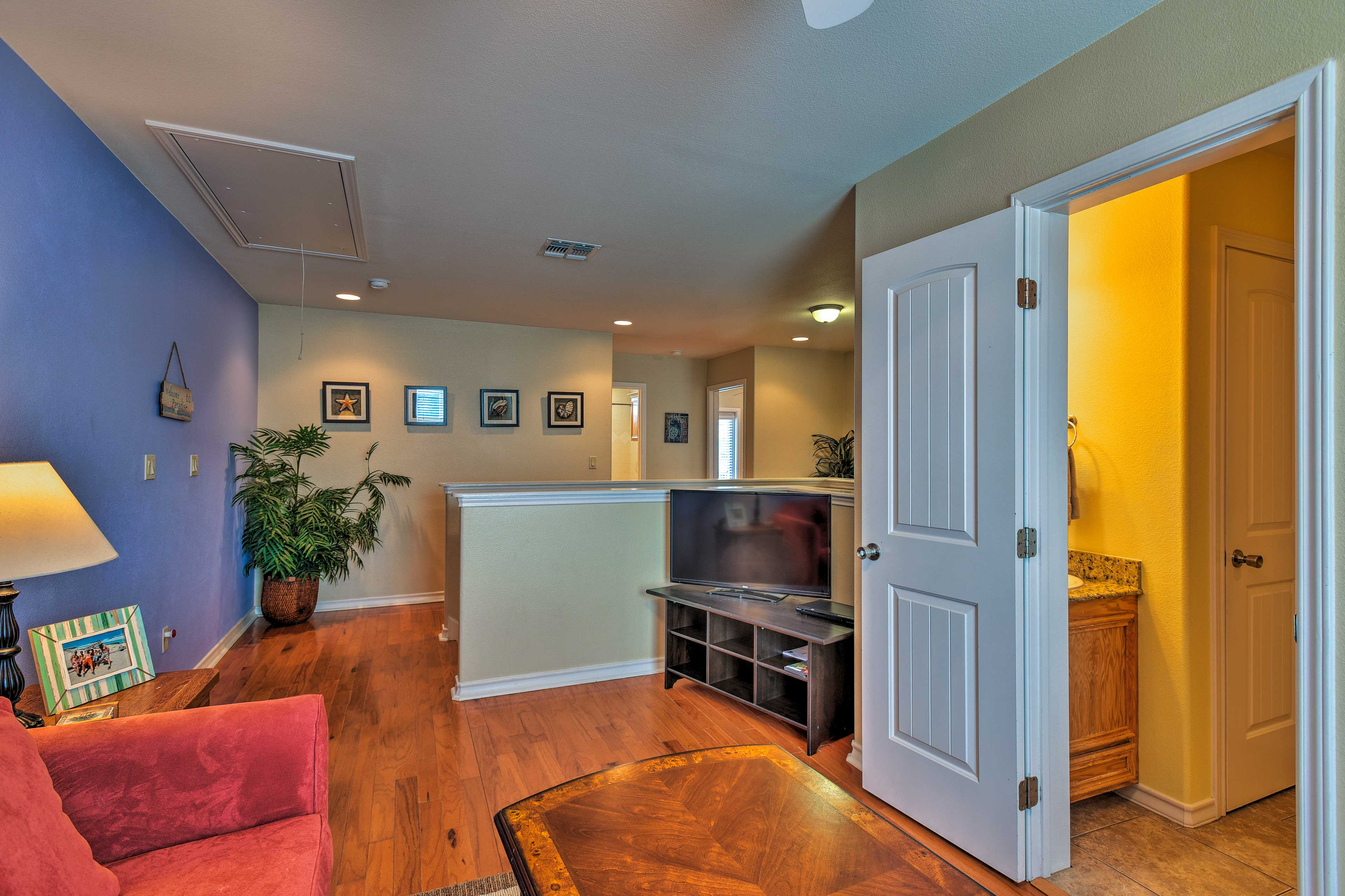 The living room and loft are equipped with flat-screen cable TVs.