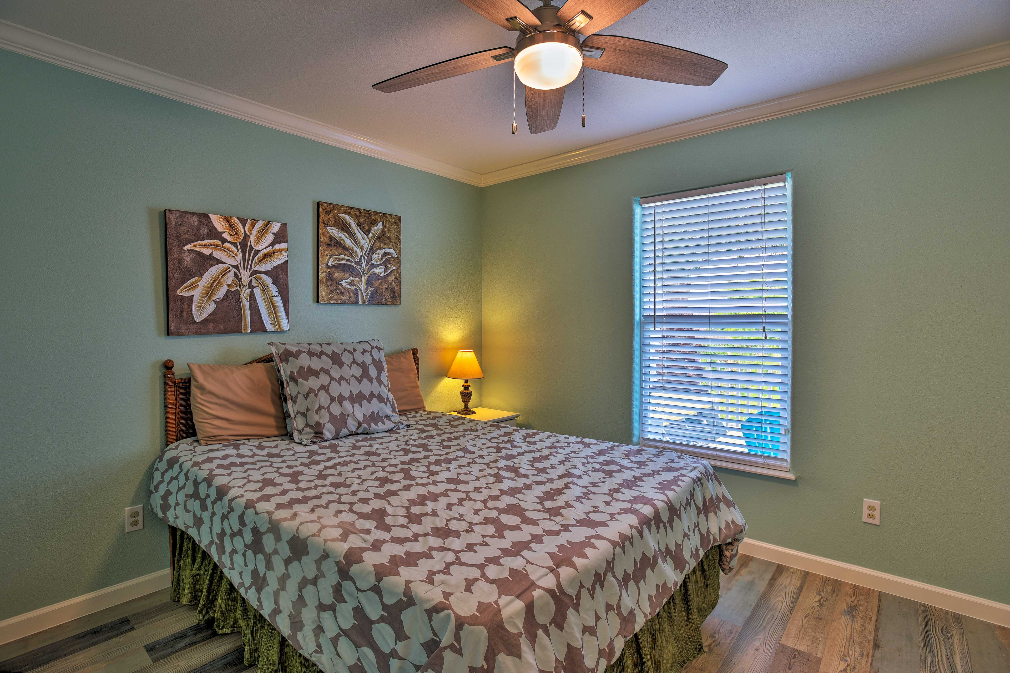 The first  bedroom includes a queen bed.