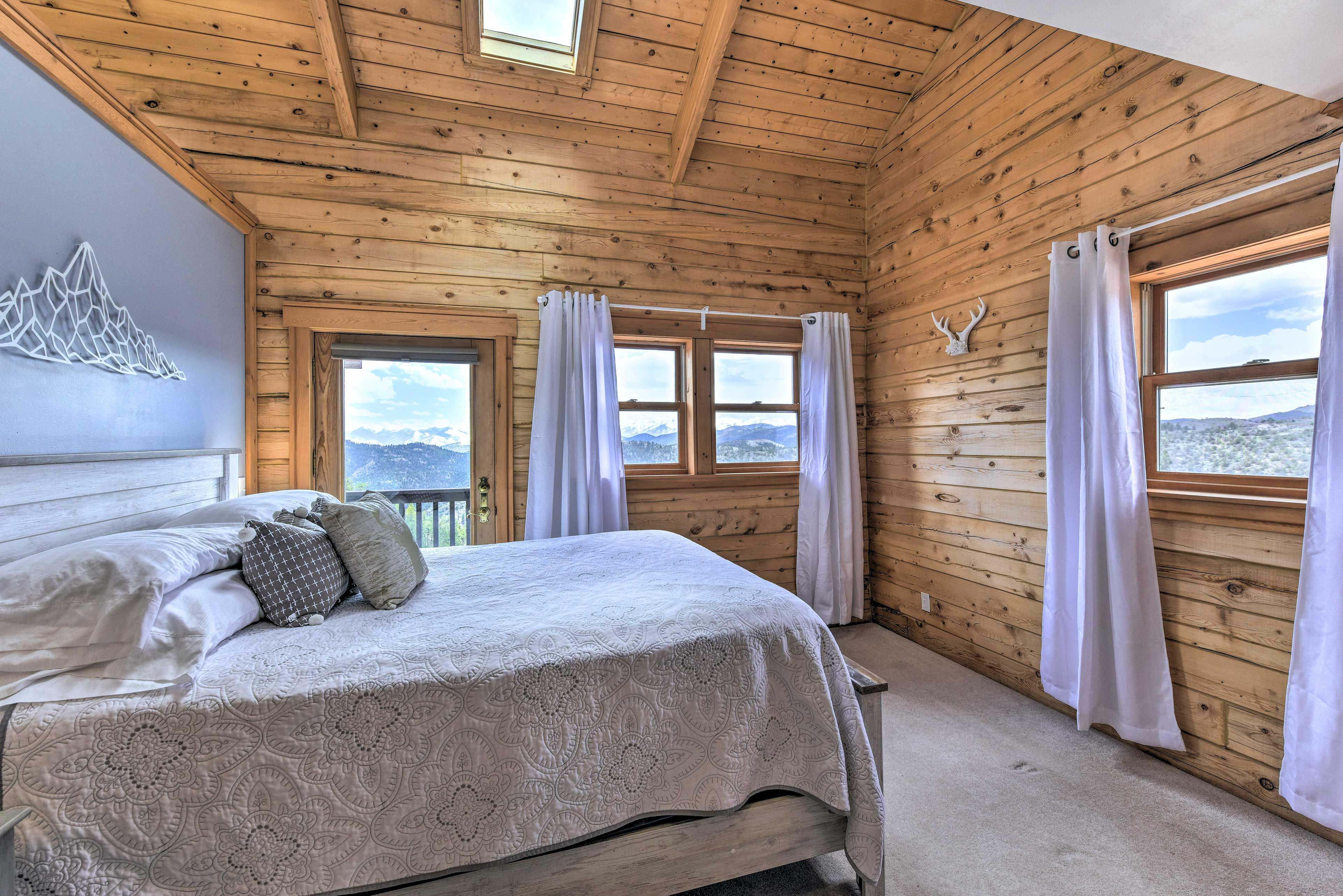 The master bedroom's queen bed will usher you to sleep.