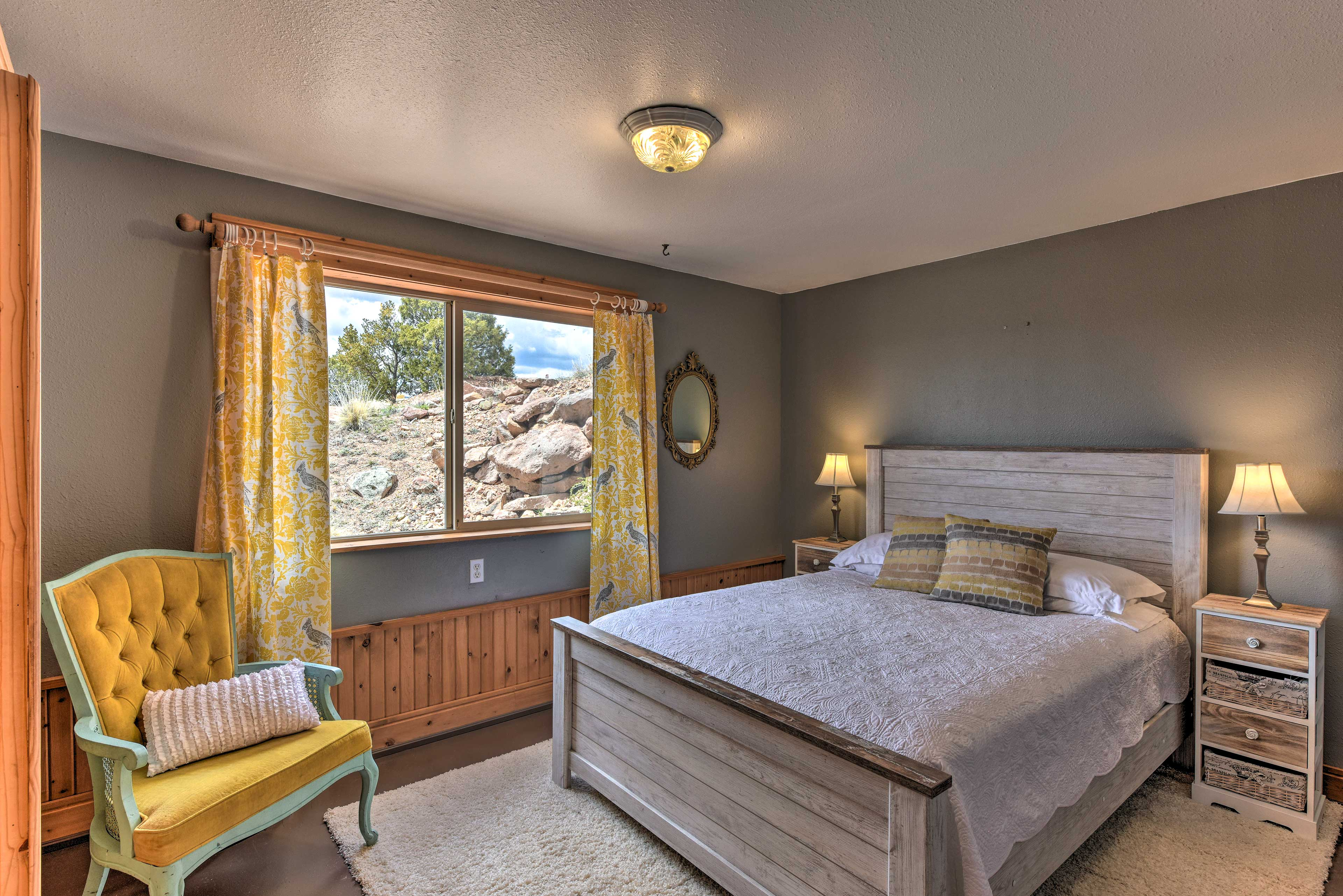 Located steps from the basement living area, this bedroom boasts a full bed.