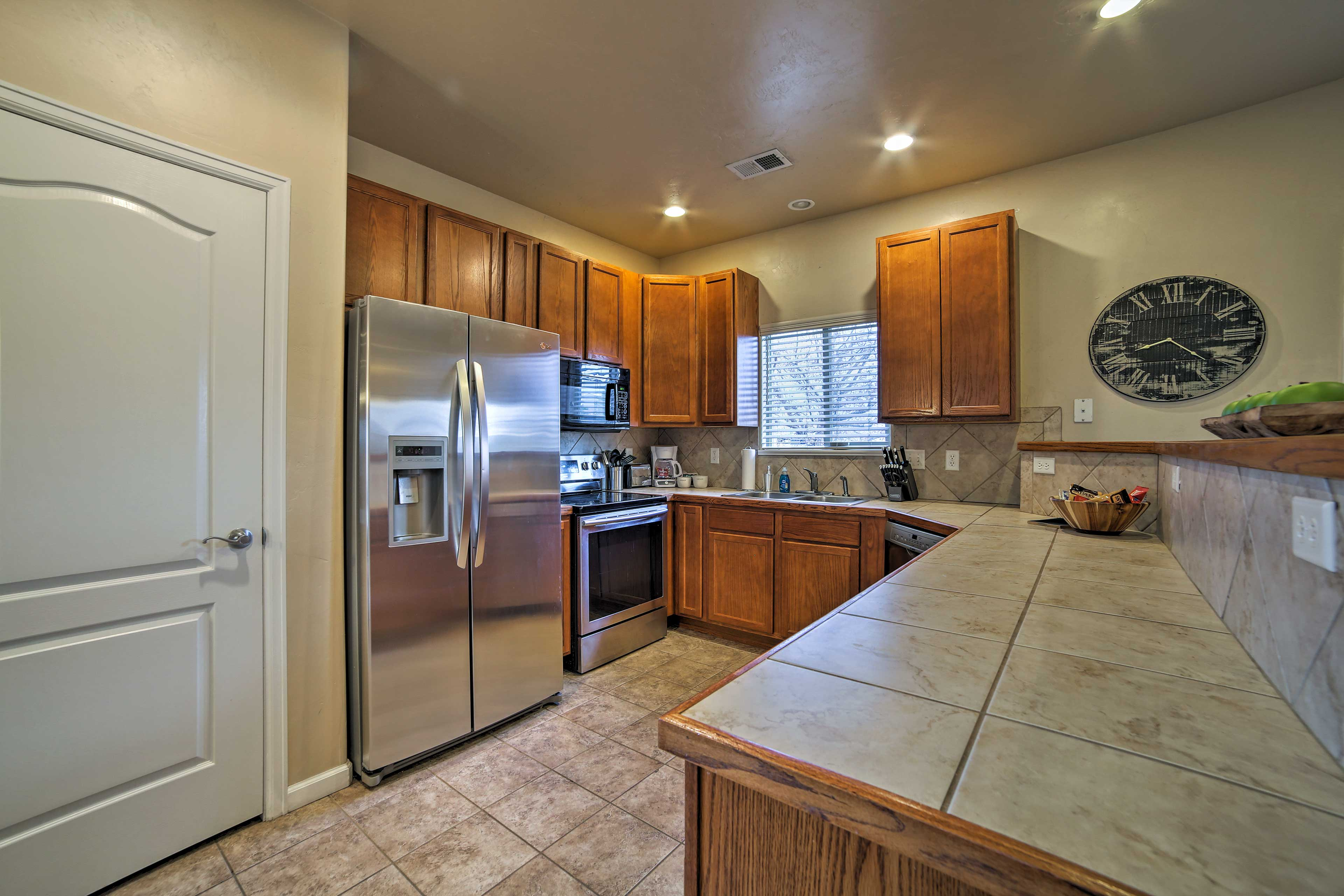 Stainless steel appliances complete the fully equipped kitchen.