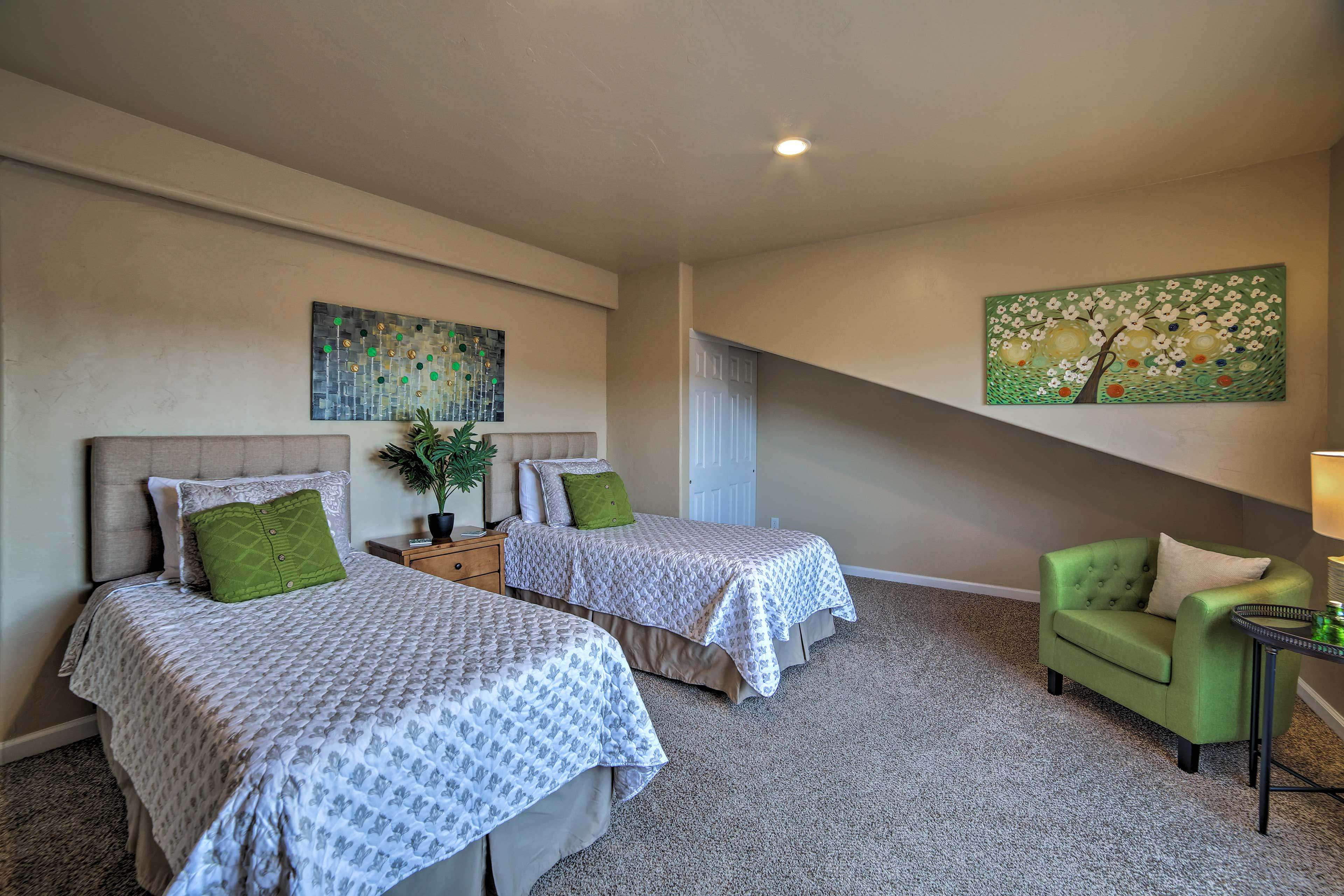 Around the corner you'll find 2 twin beds in Bedroom 4.