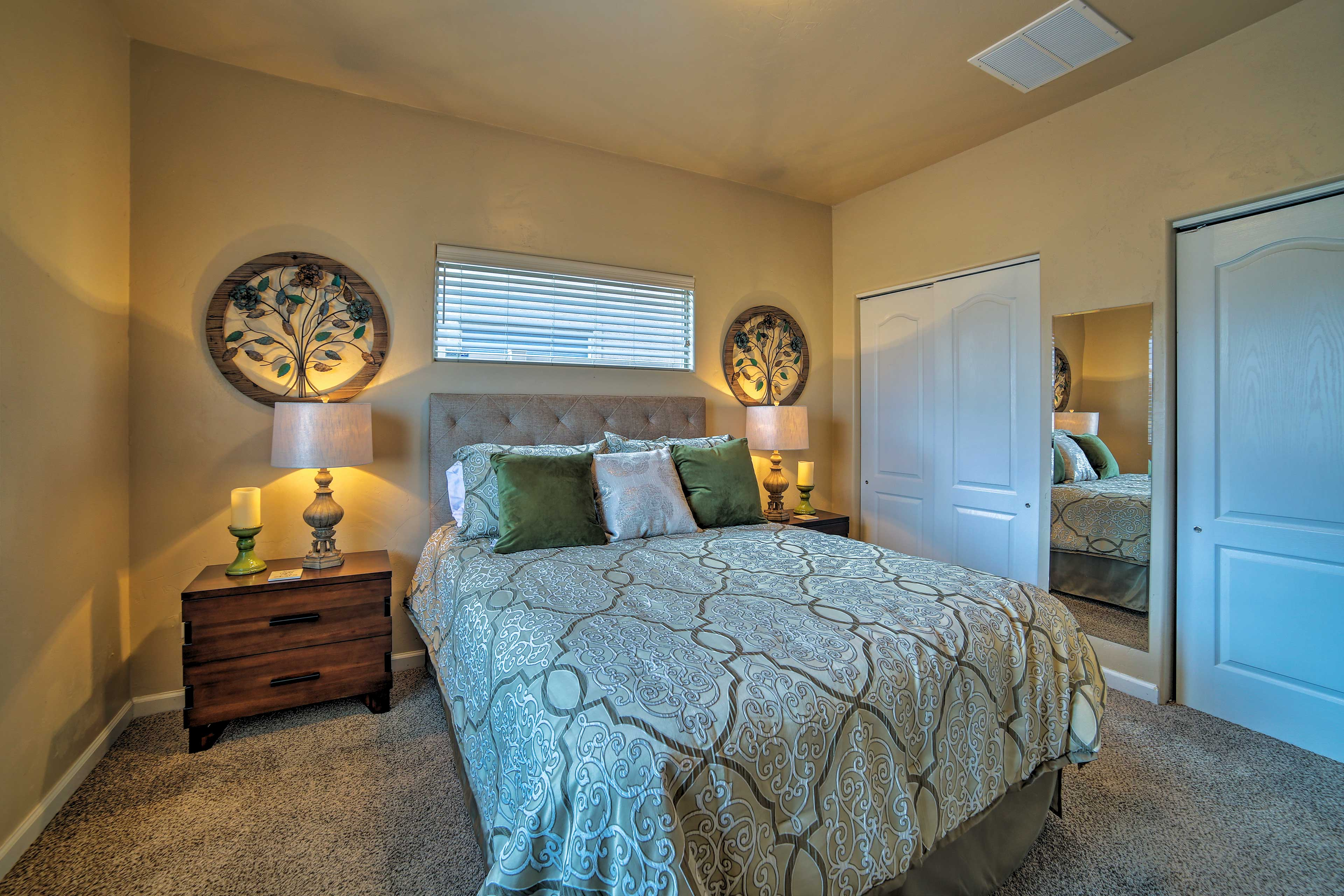 Two travelers can rest easy in this queen bed in the master bedroom.