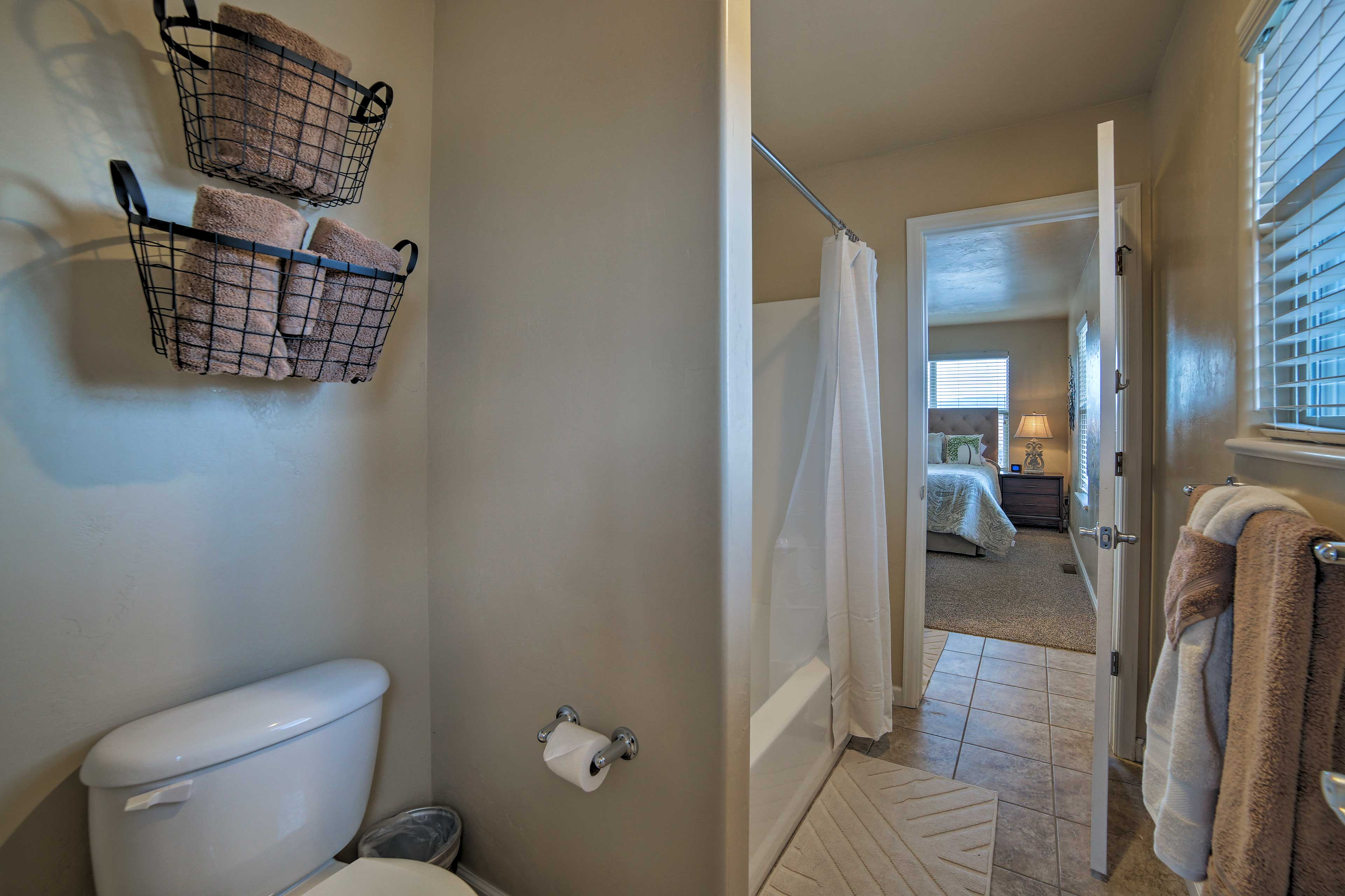 This full bathroom provides a sizable shower/tub combo.