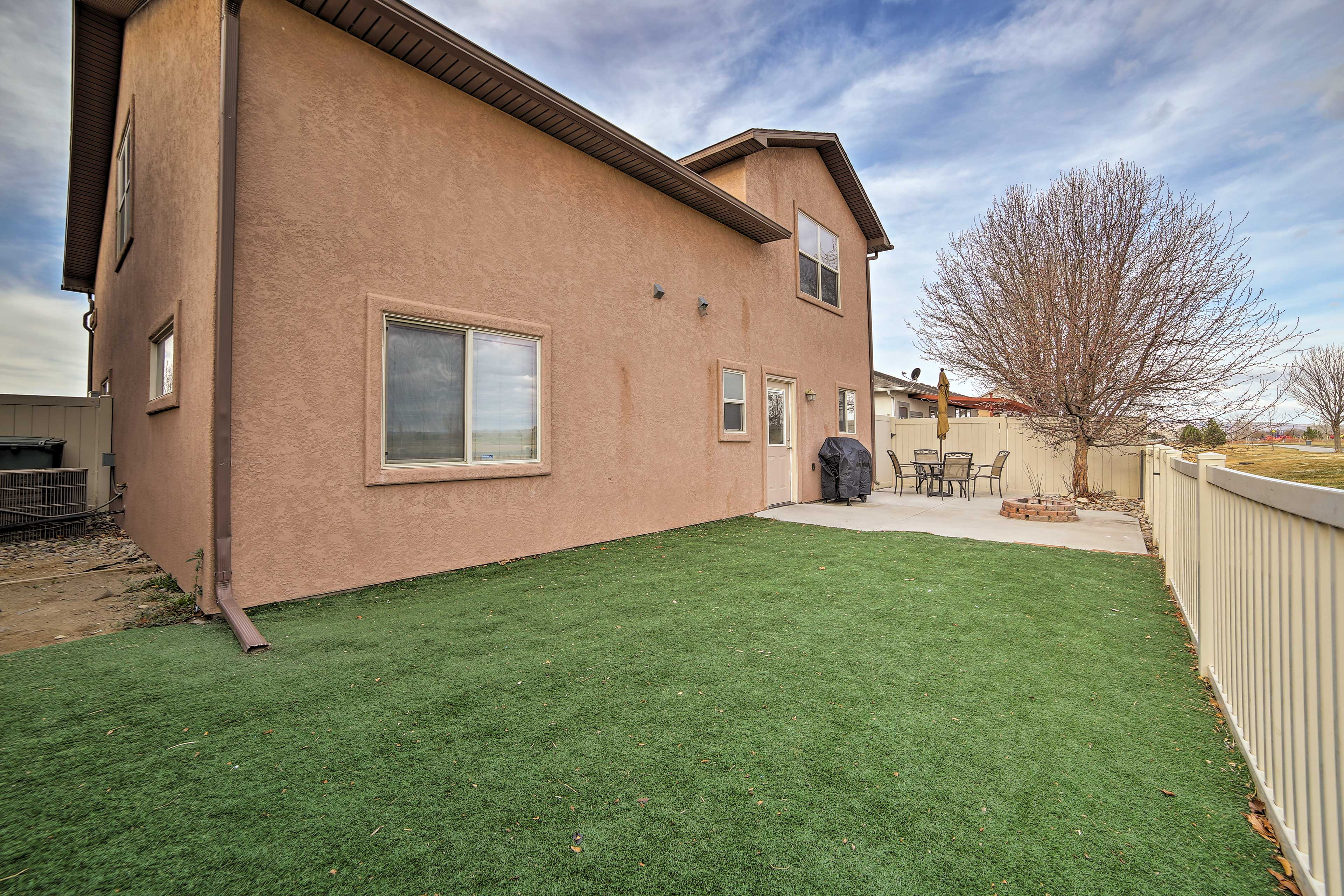 Have some fun playing with your pup in the astro-turf grass yard!