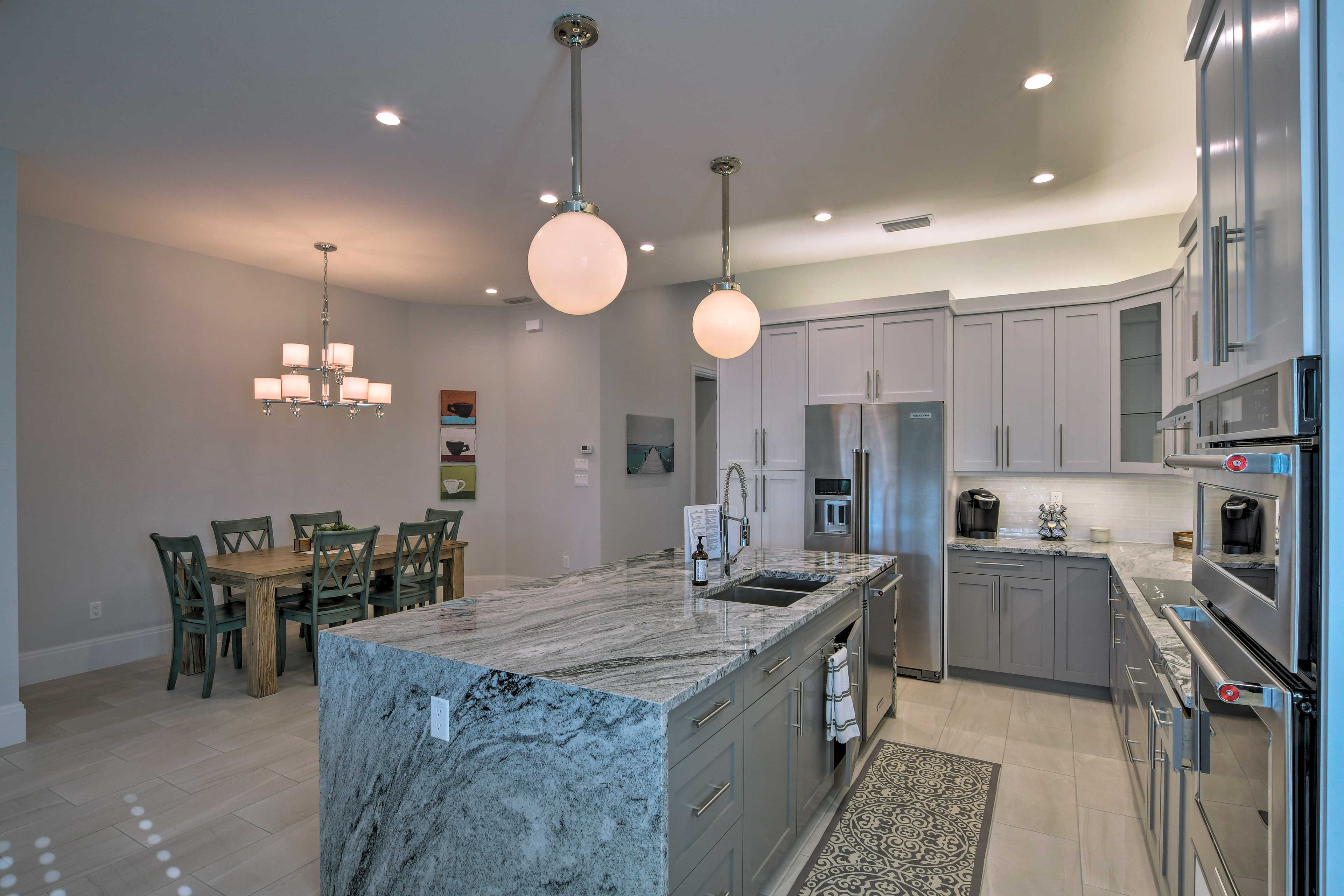 The kitchen features stainless steel appliances and a center island.