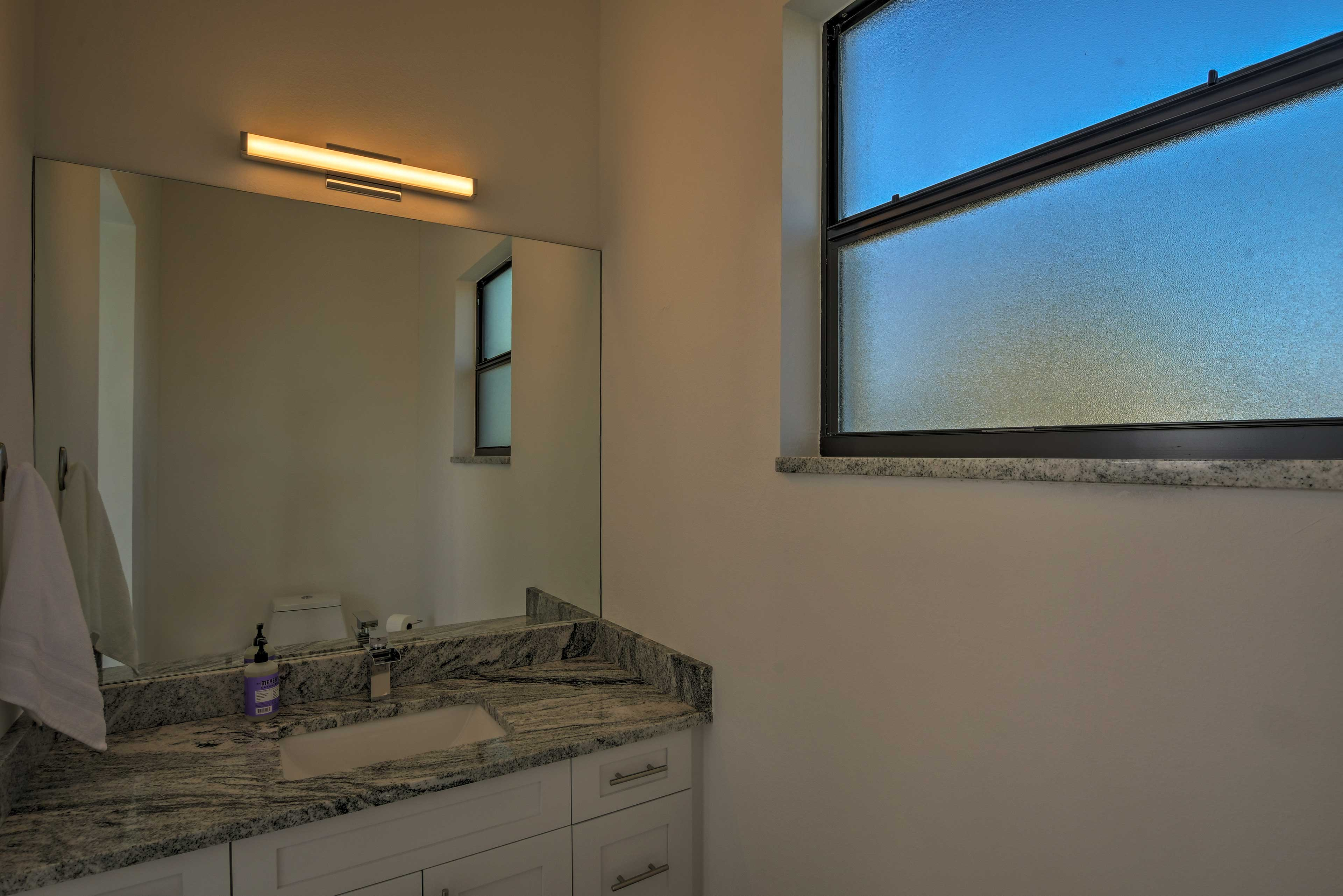 One bathroom is located by the pool area.