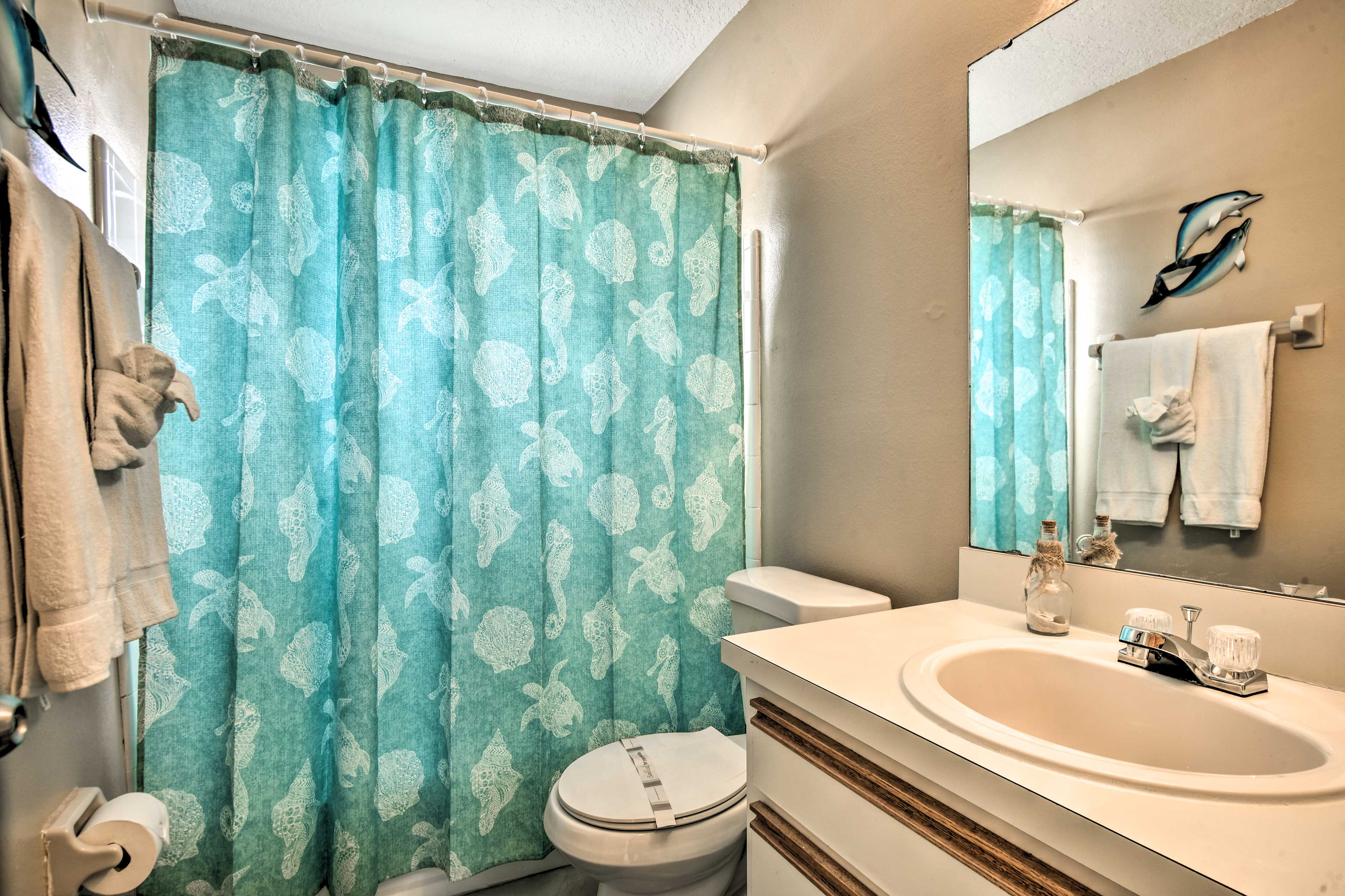 The second bathroom offers a shower/tub combo for guests.
