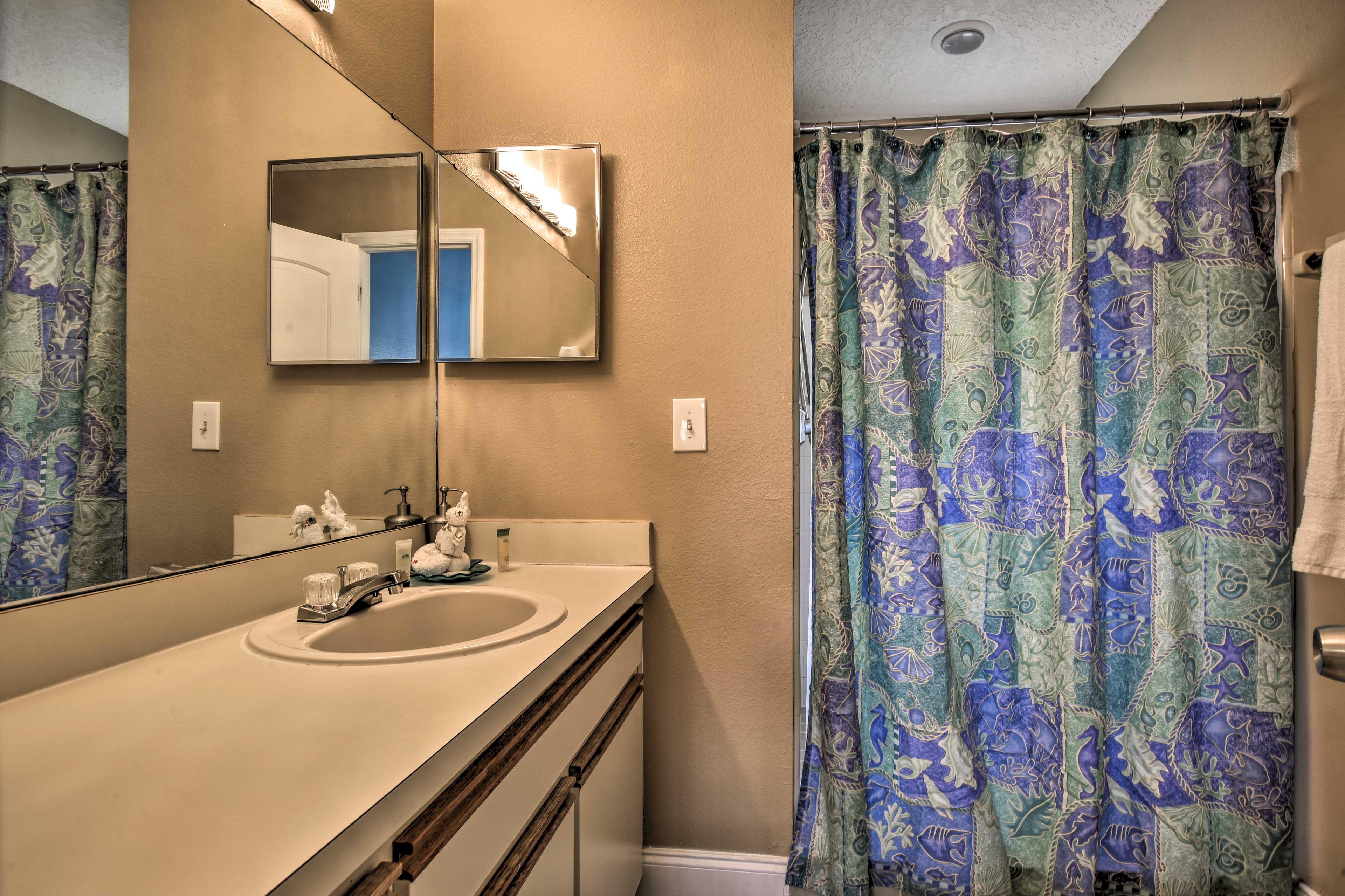 The en-suite bathroom has a walk-in shower.