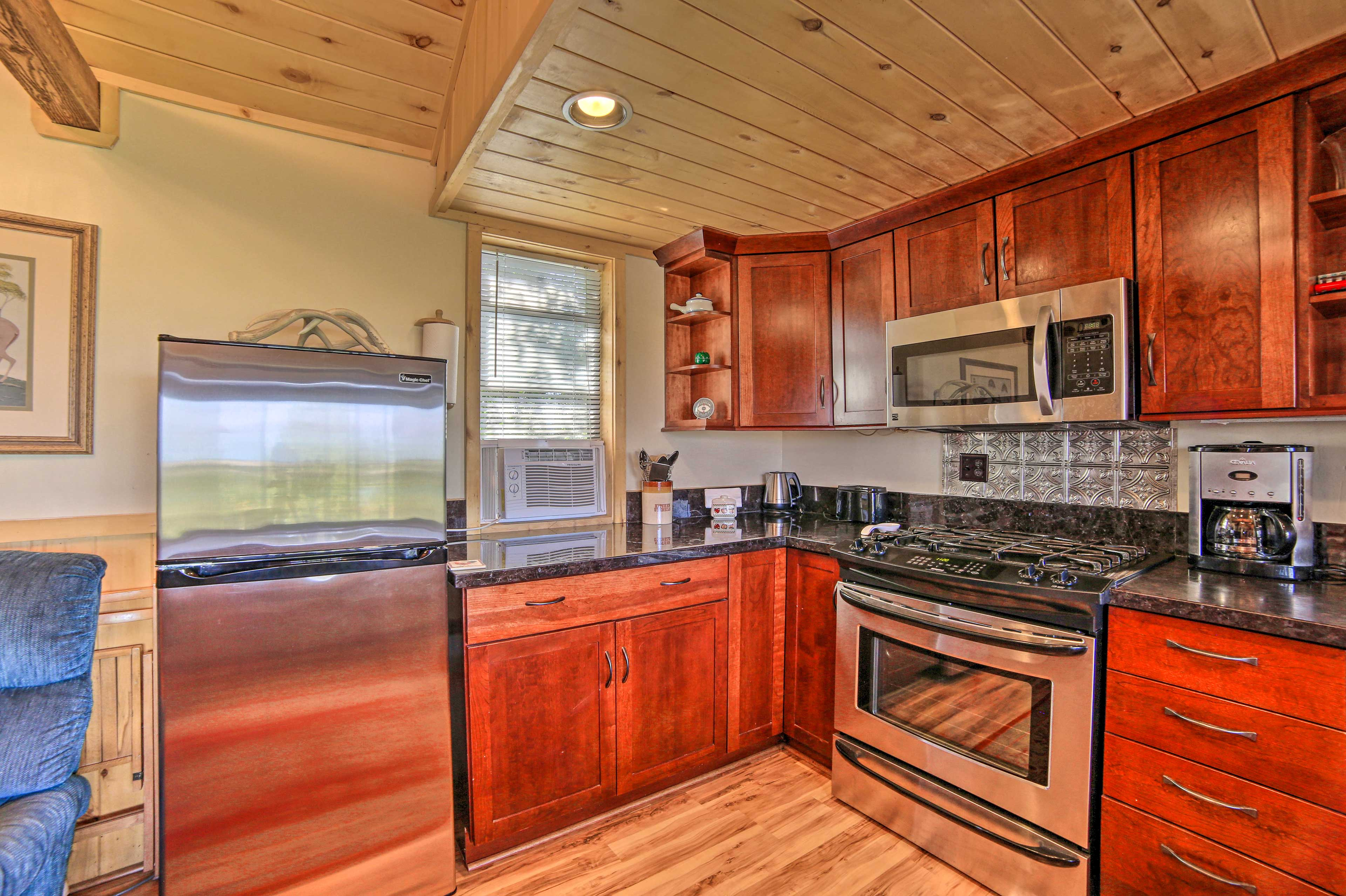 The kitchen has new stainless steel appliances.