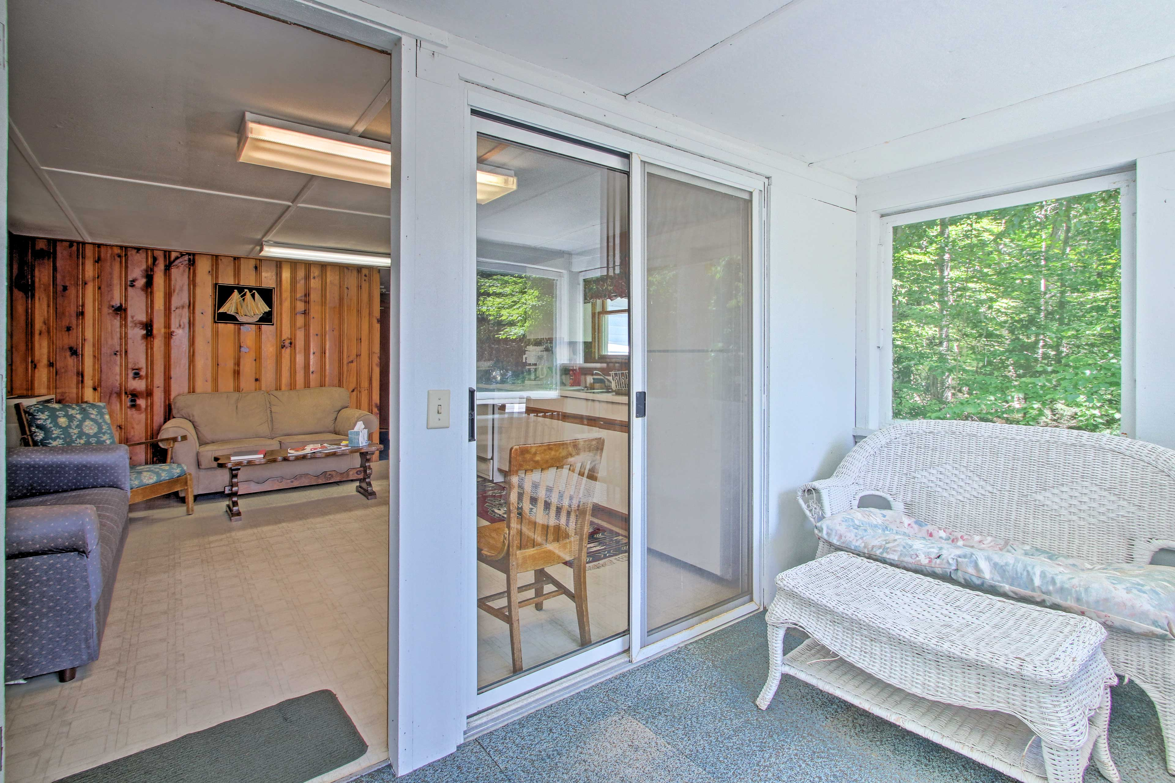 The white-washed sunroom is perfect for morning coffee.