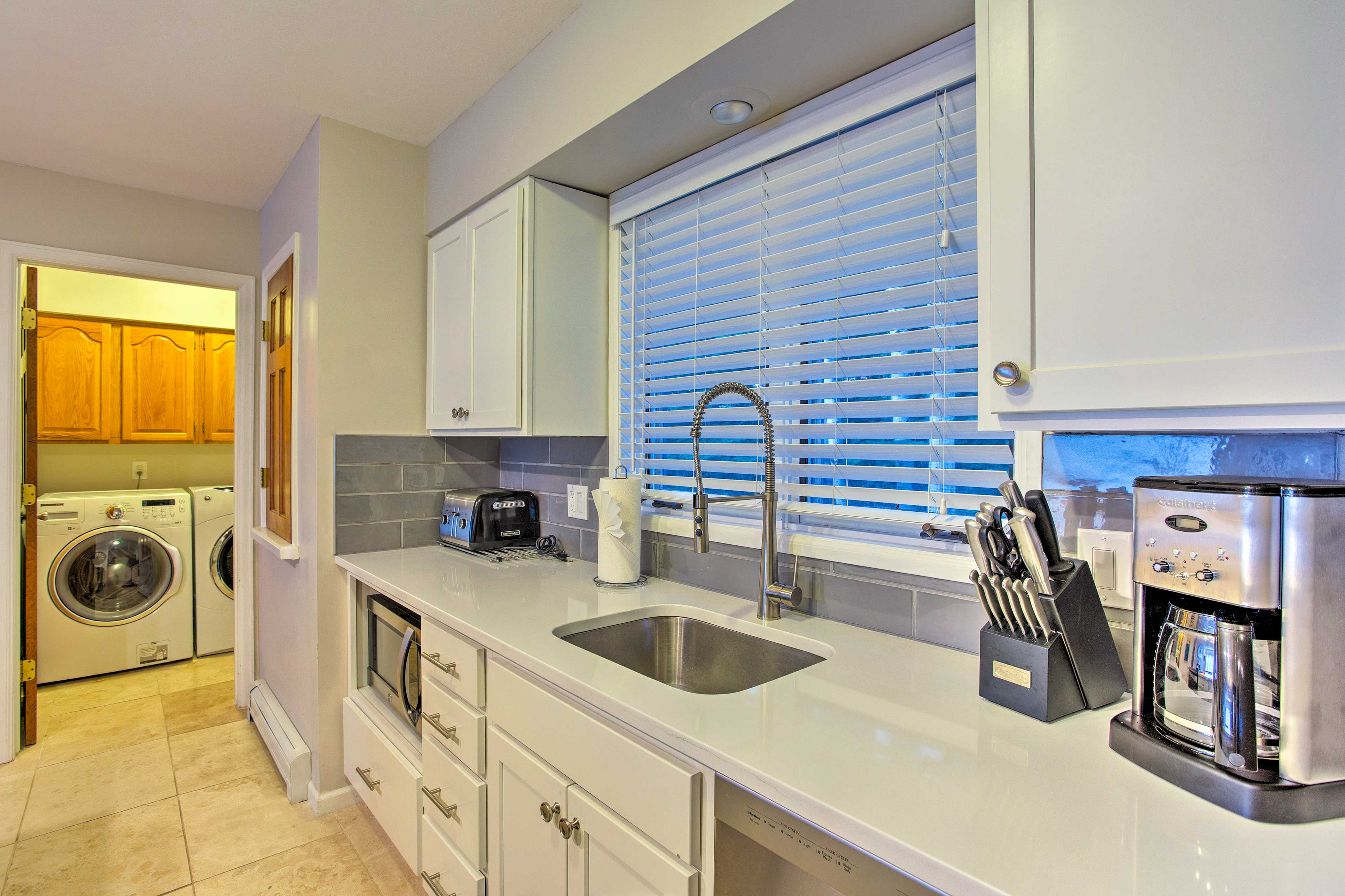 In-unit laundry machines are located just next to the kitchen.