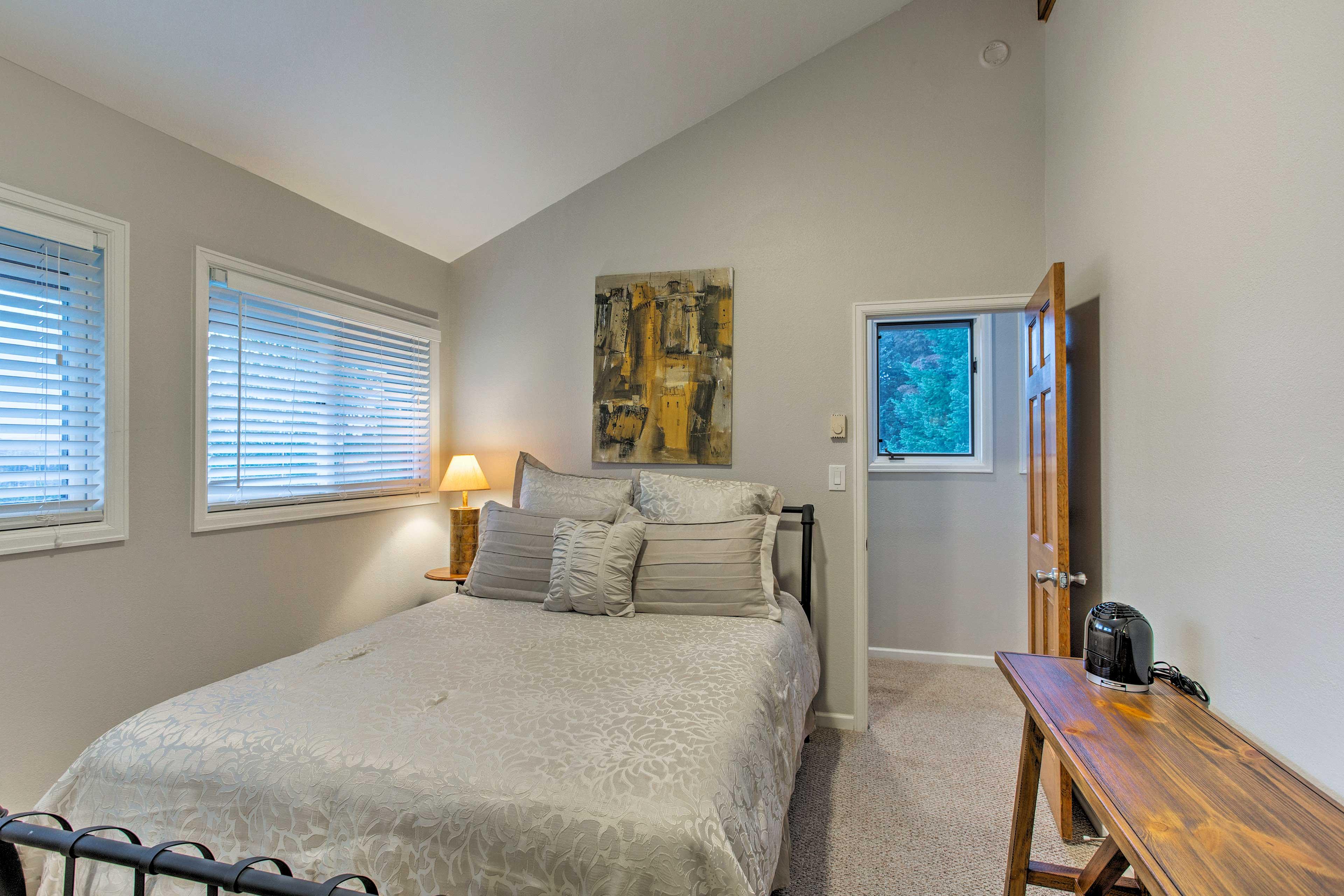 The second bedroom has a comfortable queen mattress.