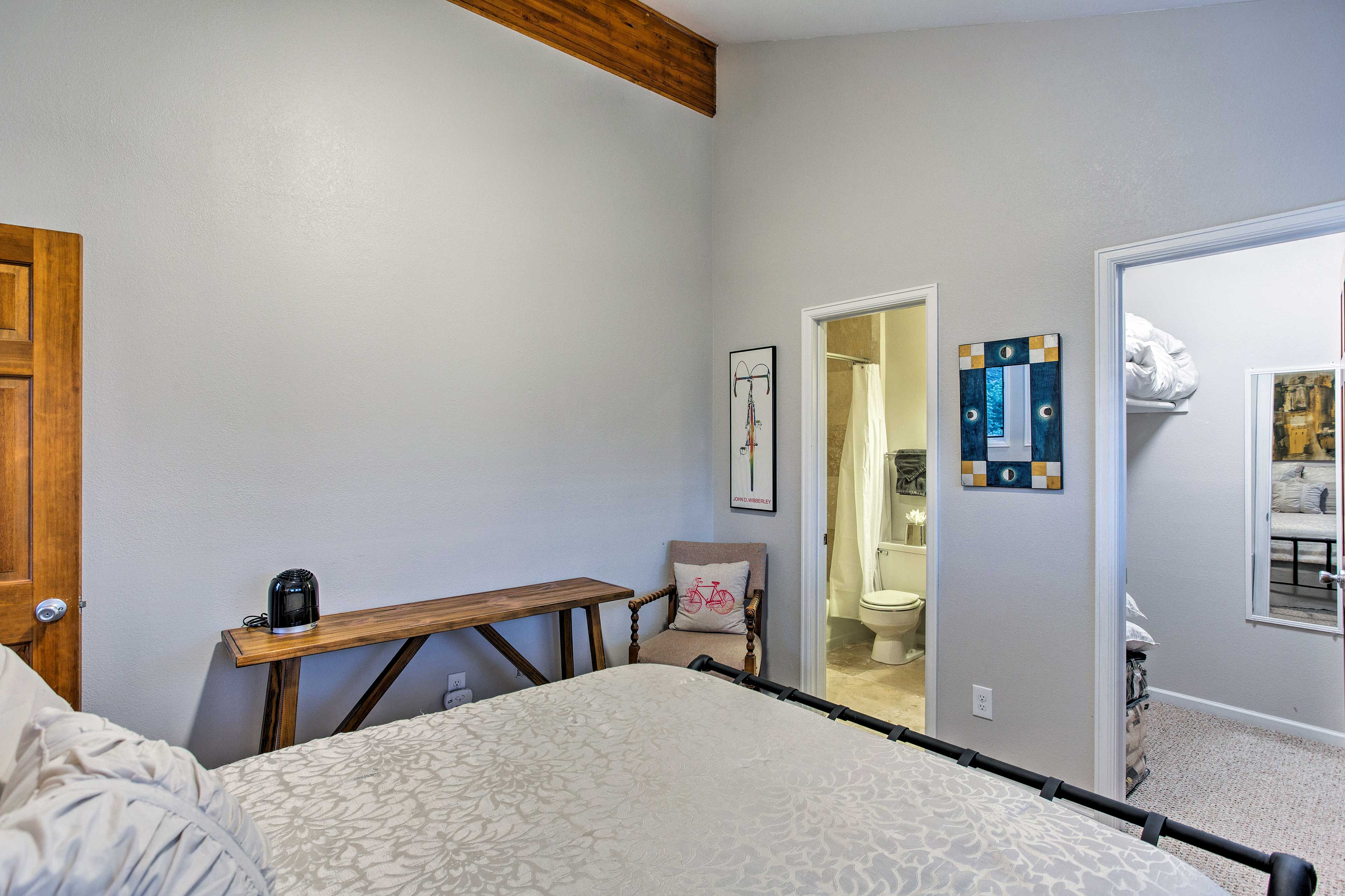 Both bedrooms on the top floor have vaulted ceilings.