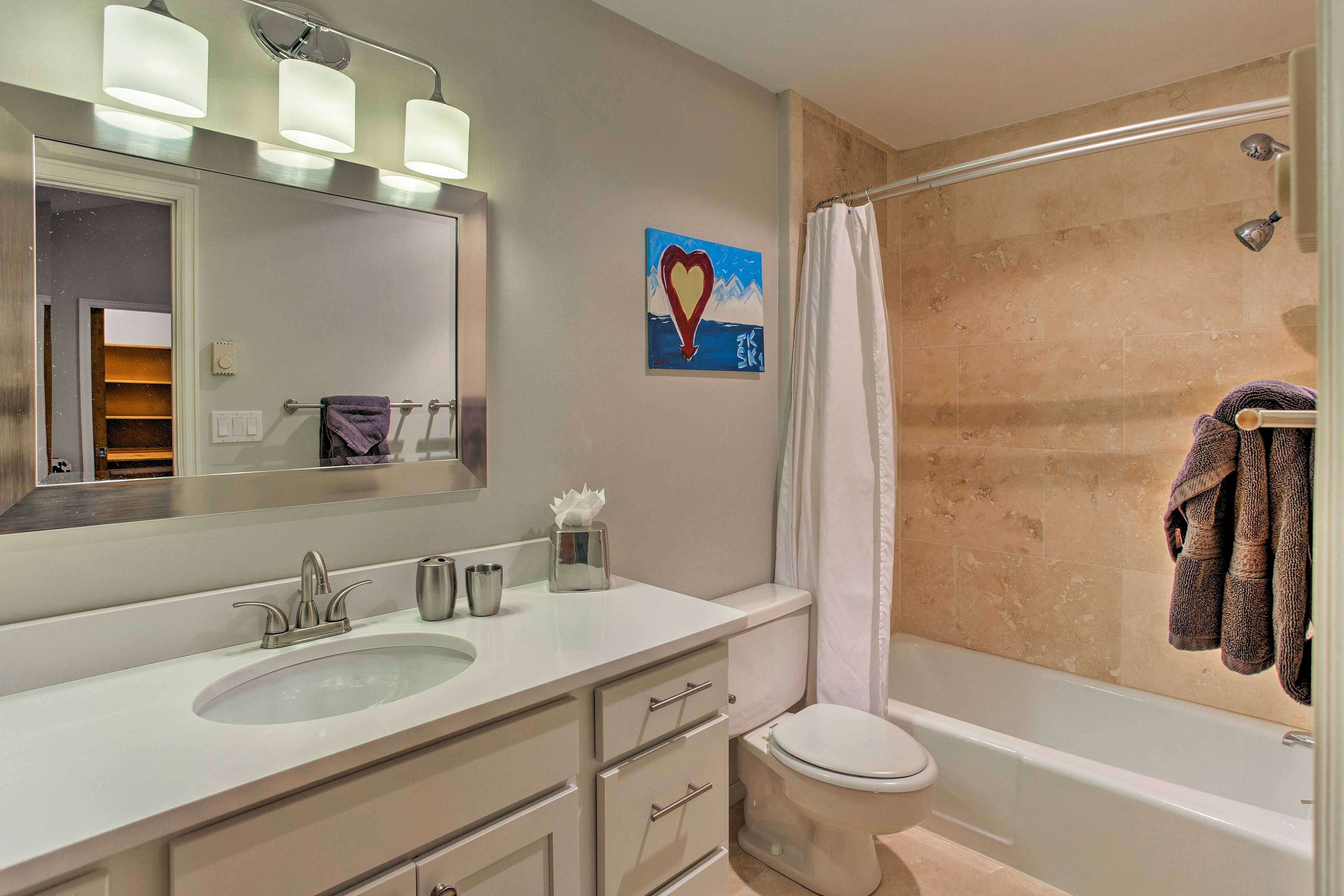 A third and final full bathroom provides additional privacy.