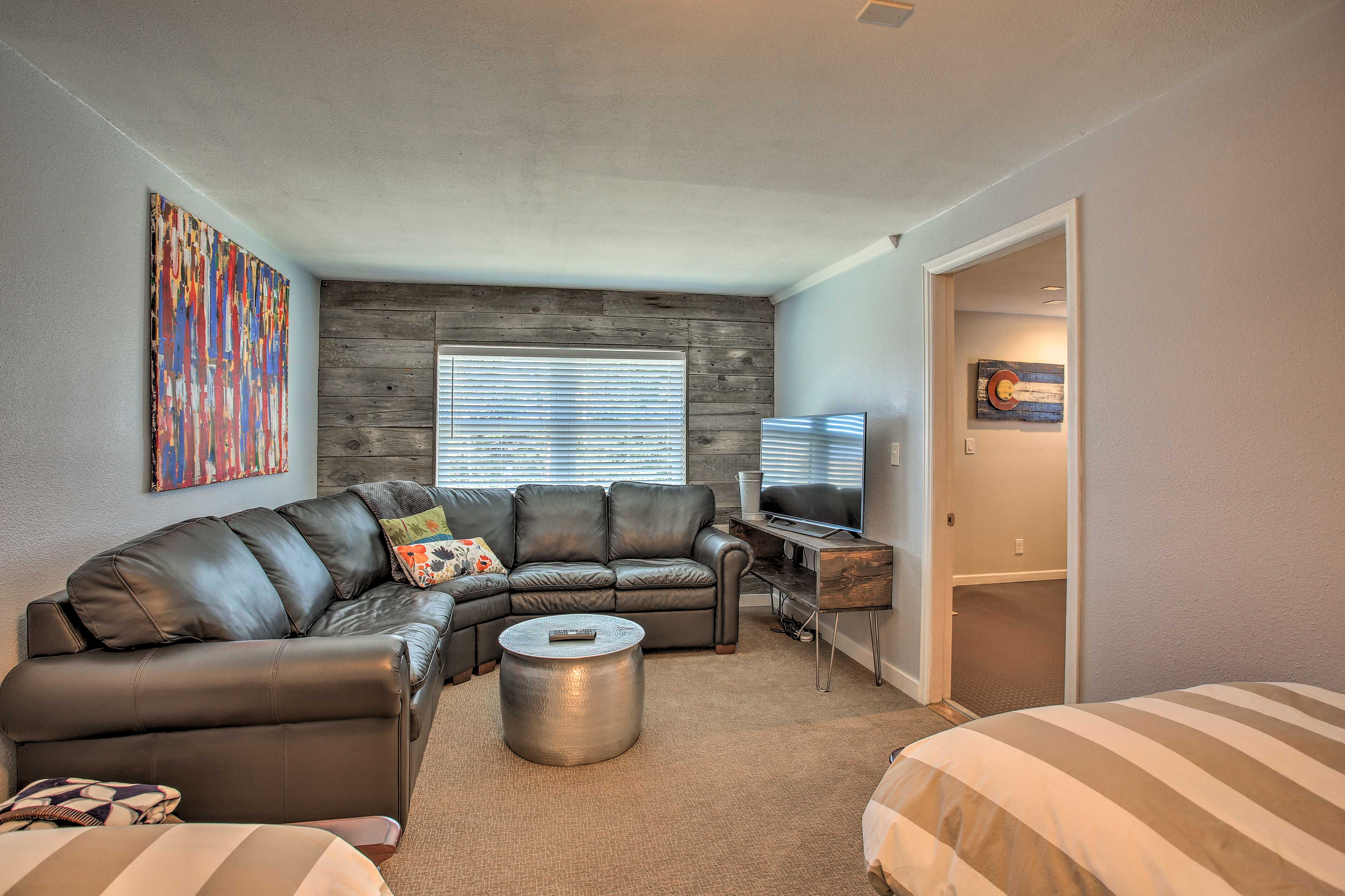 This room includes a sitting area complete with a flat-screen TV.