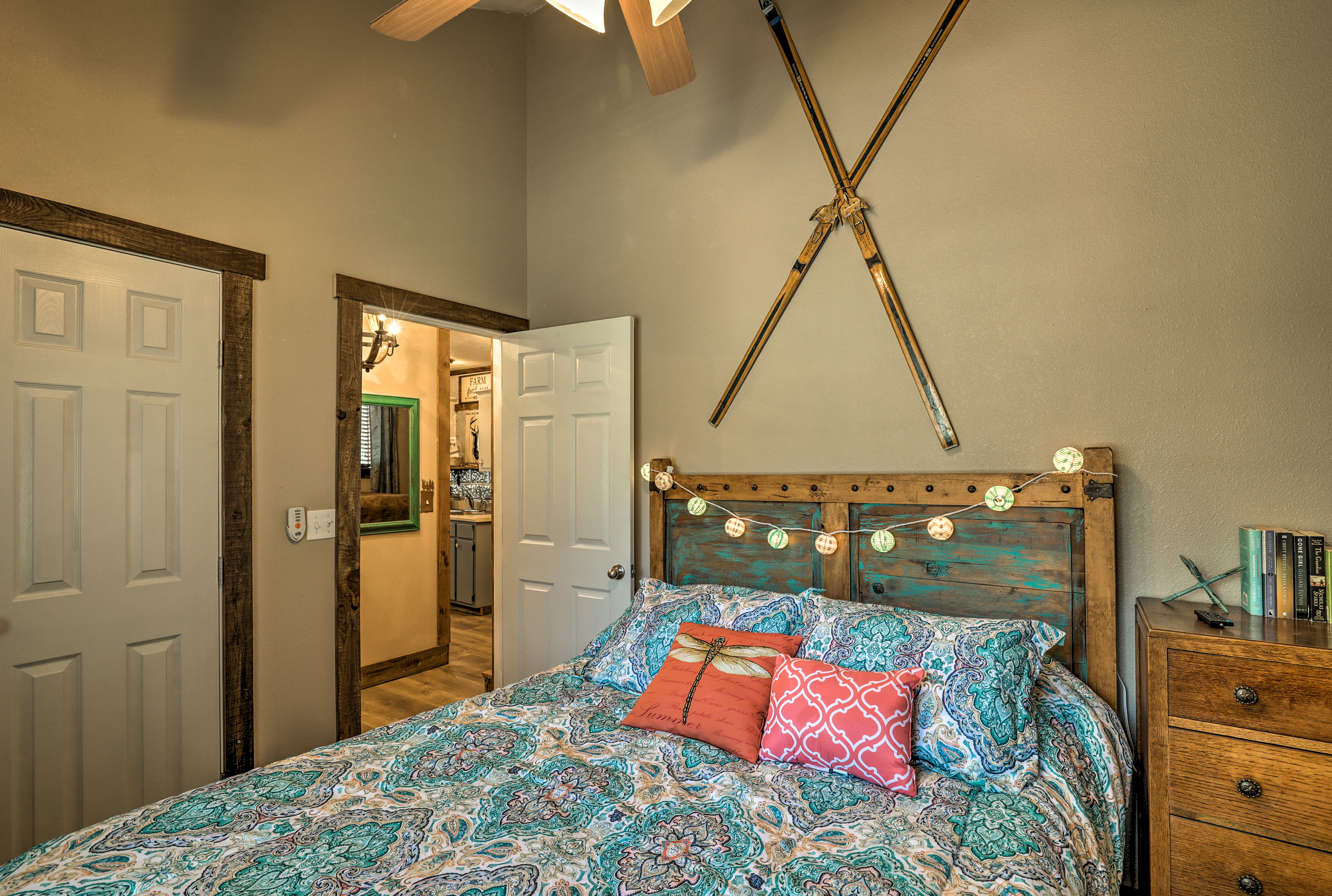 Cozy up in this queen bed after a day on the lake.