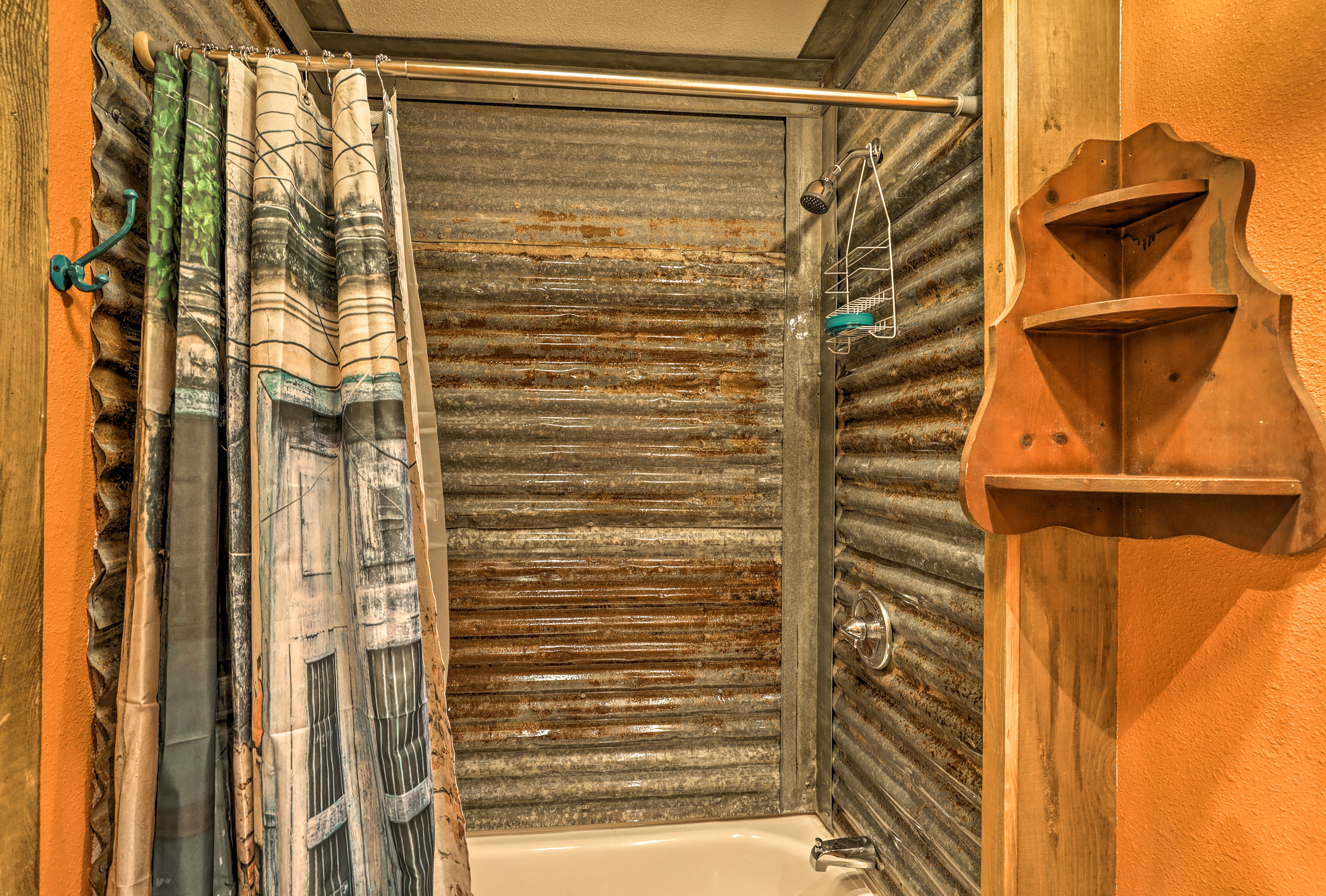 This shower/tub combo also features galvanized tin.